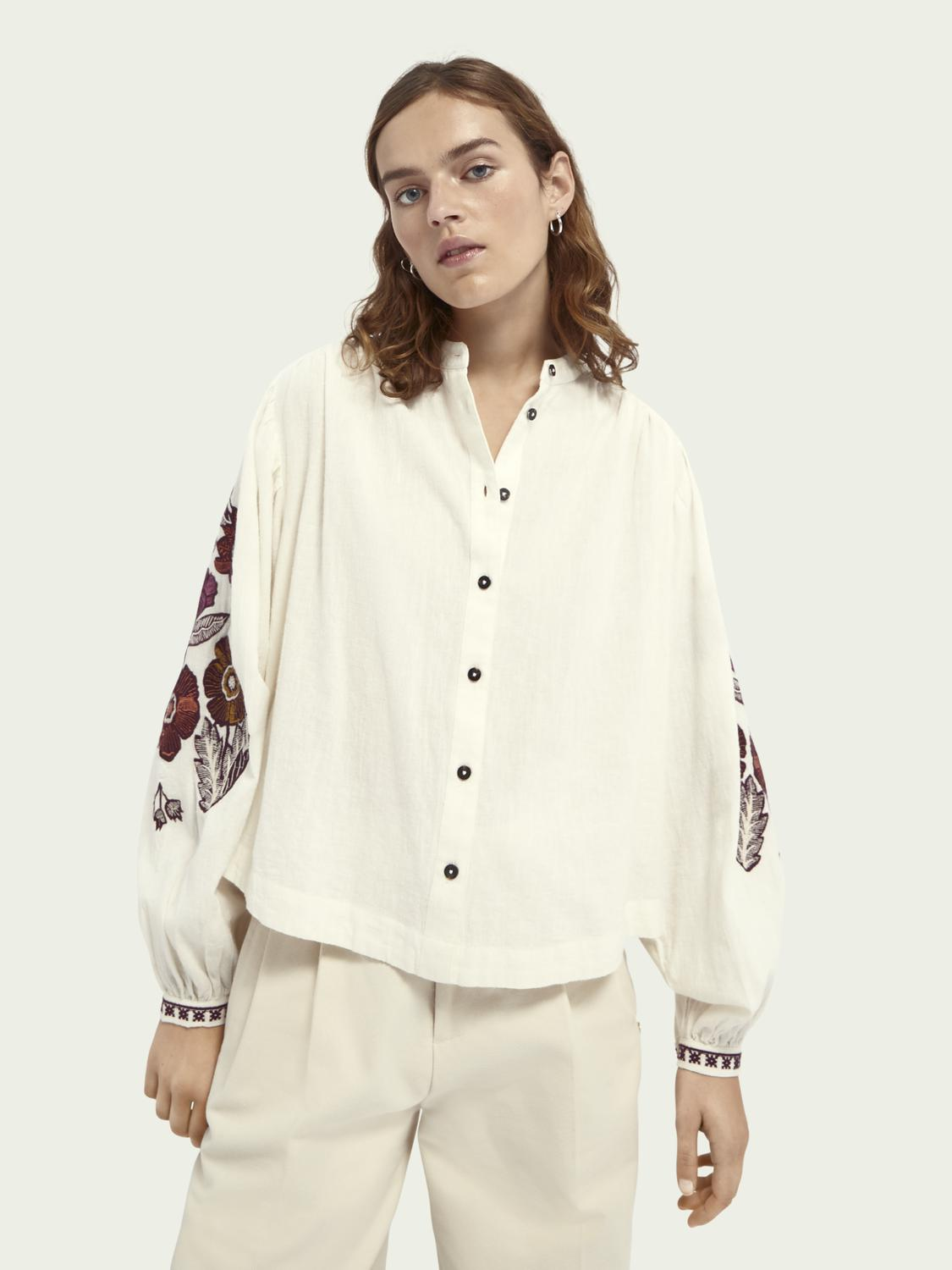 Voluminous sleeved embroidered top