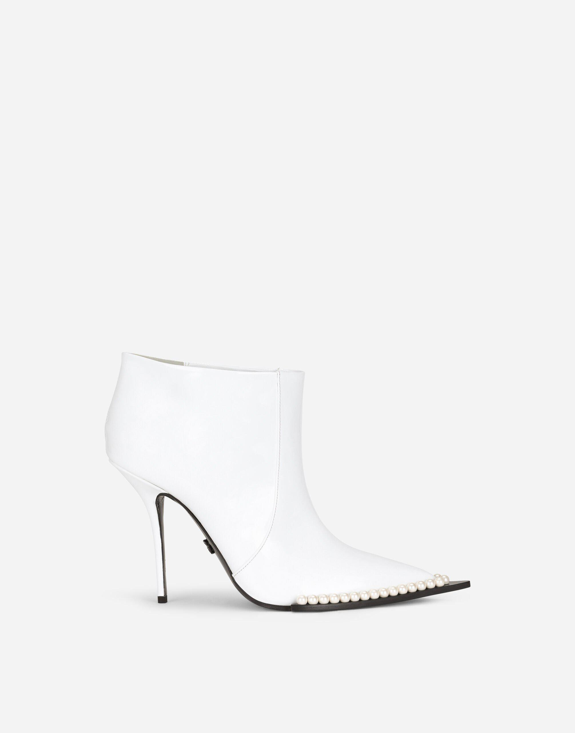 Patent leather ankle boots with pearls