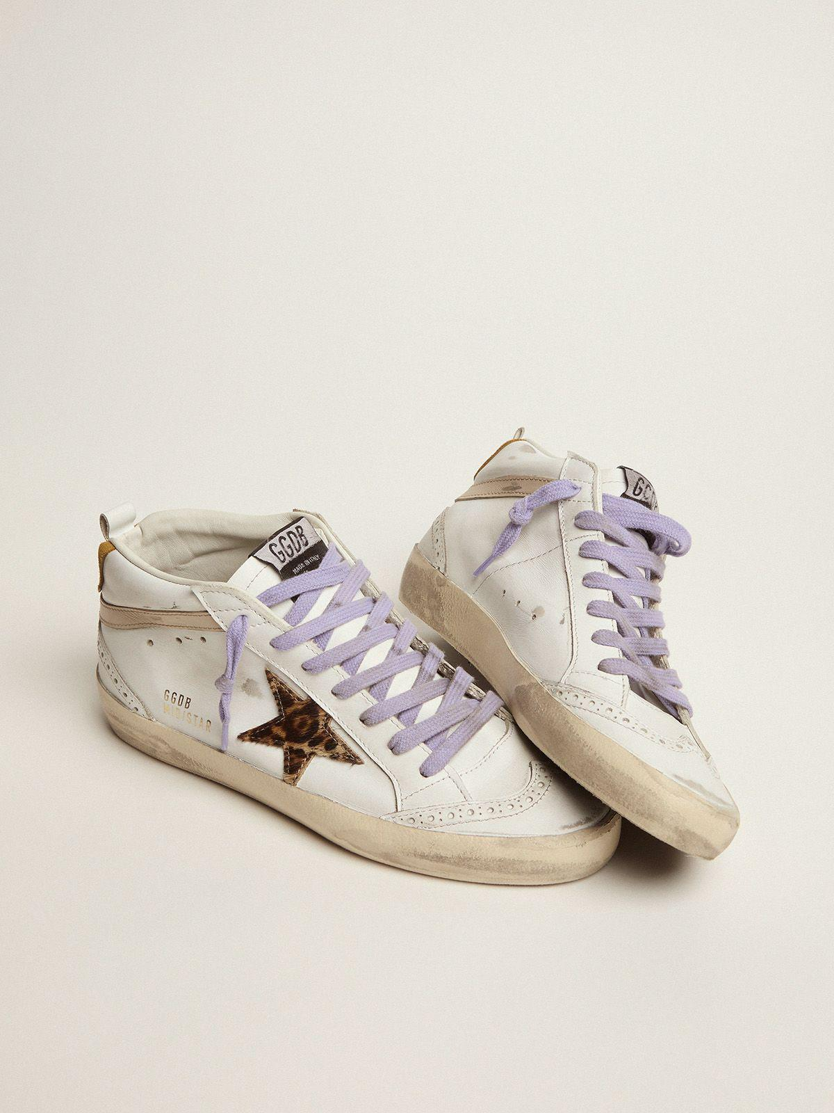 Mid Star sneakers with leopard-print pony skin star and light orange suede heel tab 1