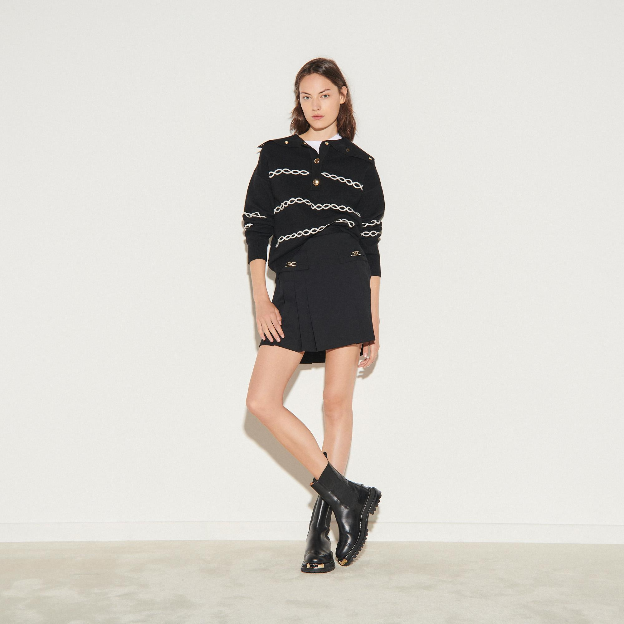 Short skirt with stitched pleats
