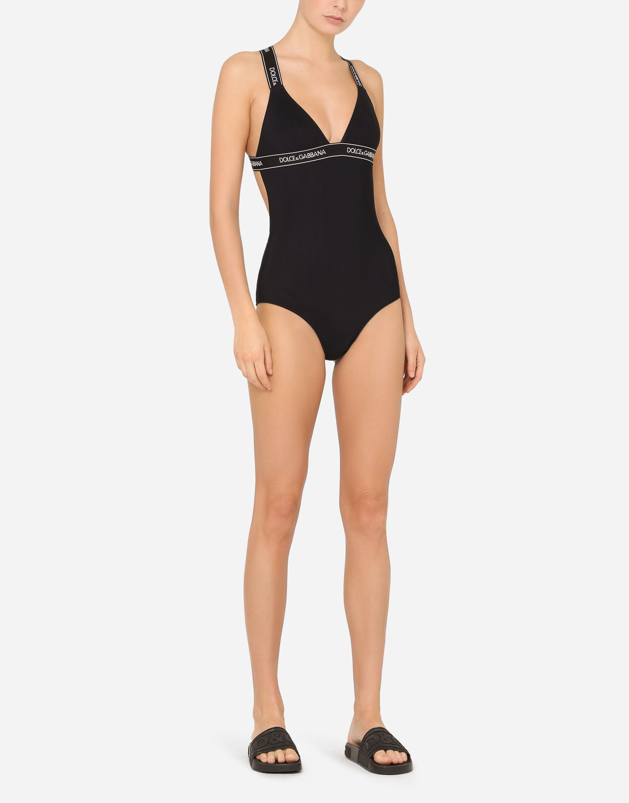 One-piece swimsuit with plunging neckline and branded elastic