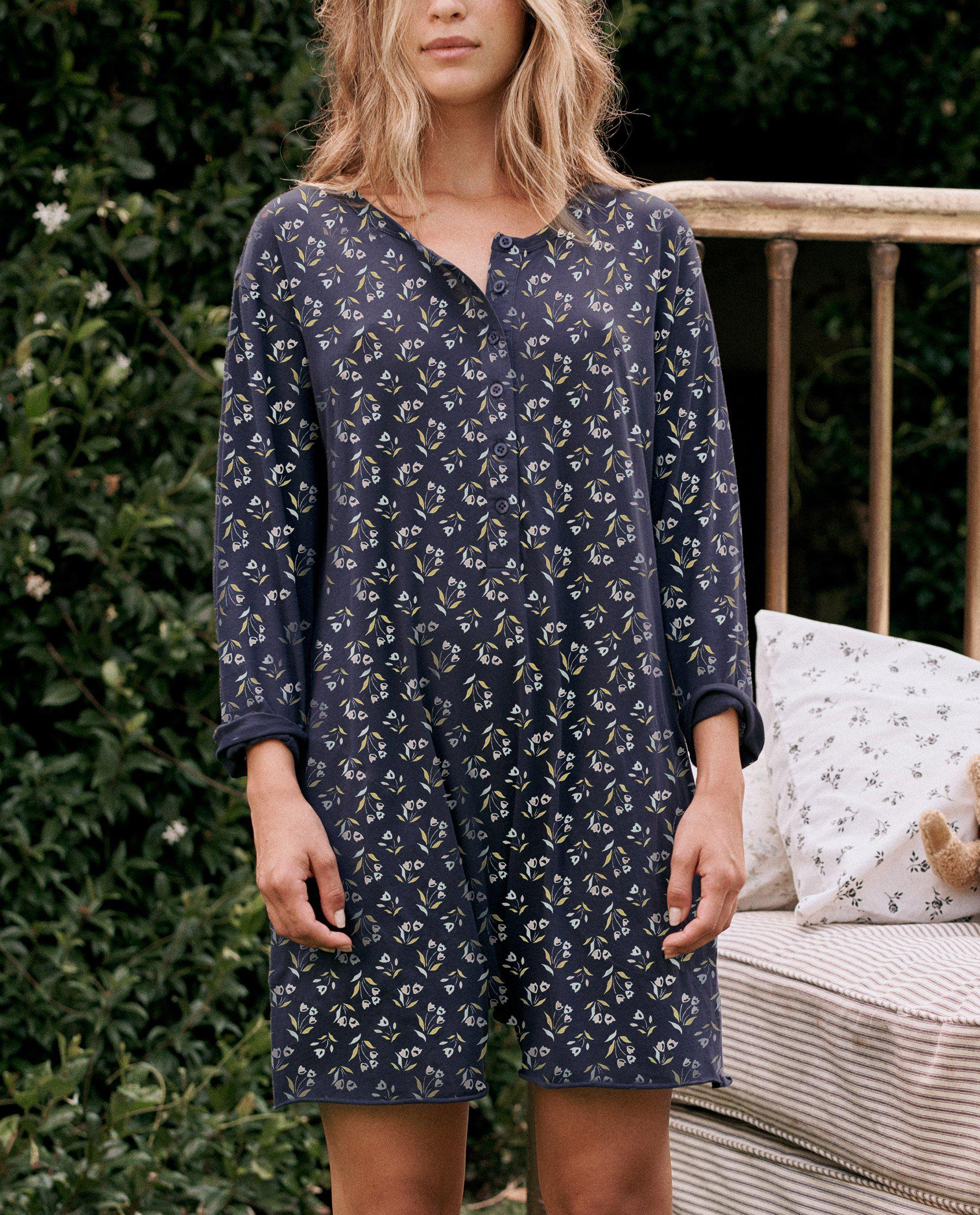 The Henley Romper. -- Navy Apron Floral