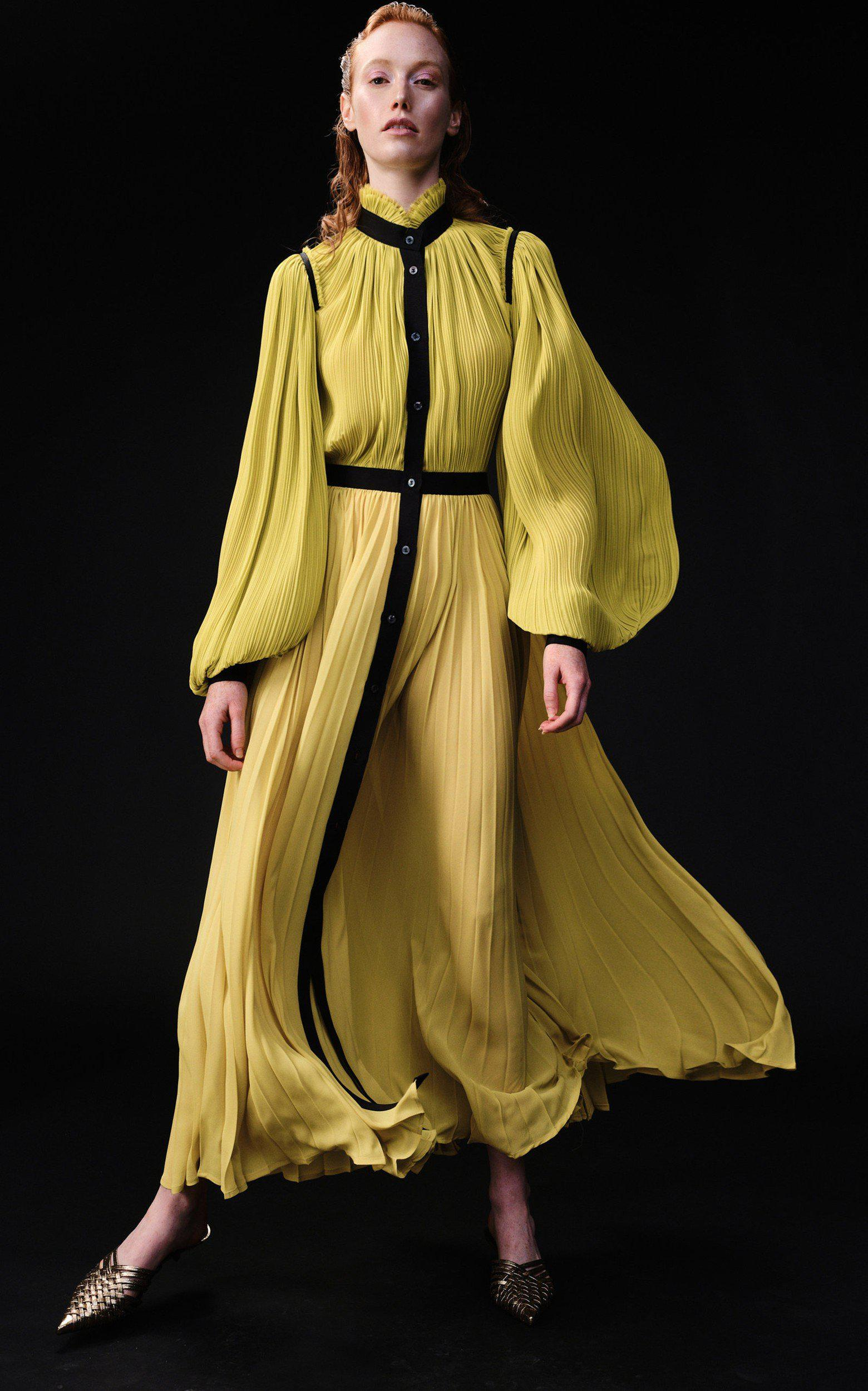 BILLOWING SLEEVE PLEATED GOWN