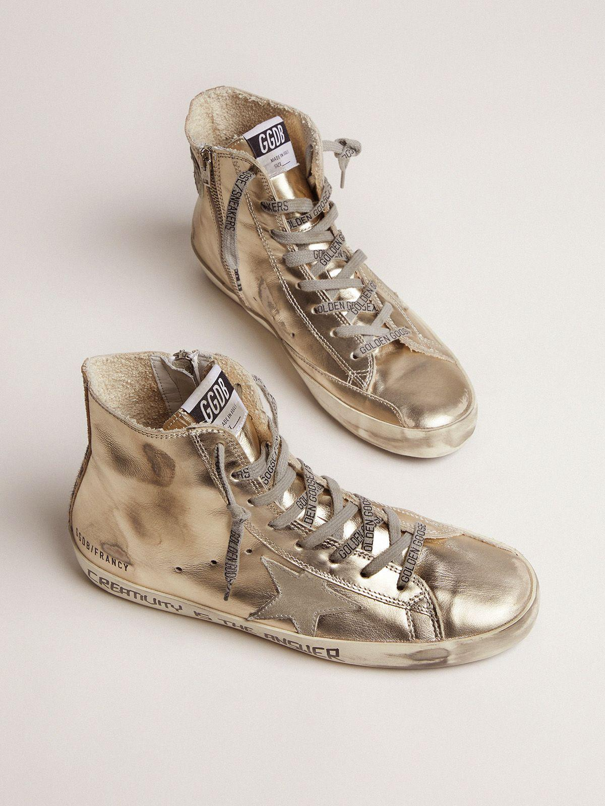 Gold Francy sneakers with handwritten lettering and leopard-print detail 1
