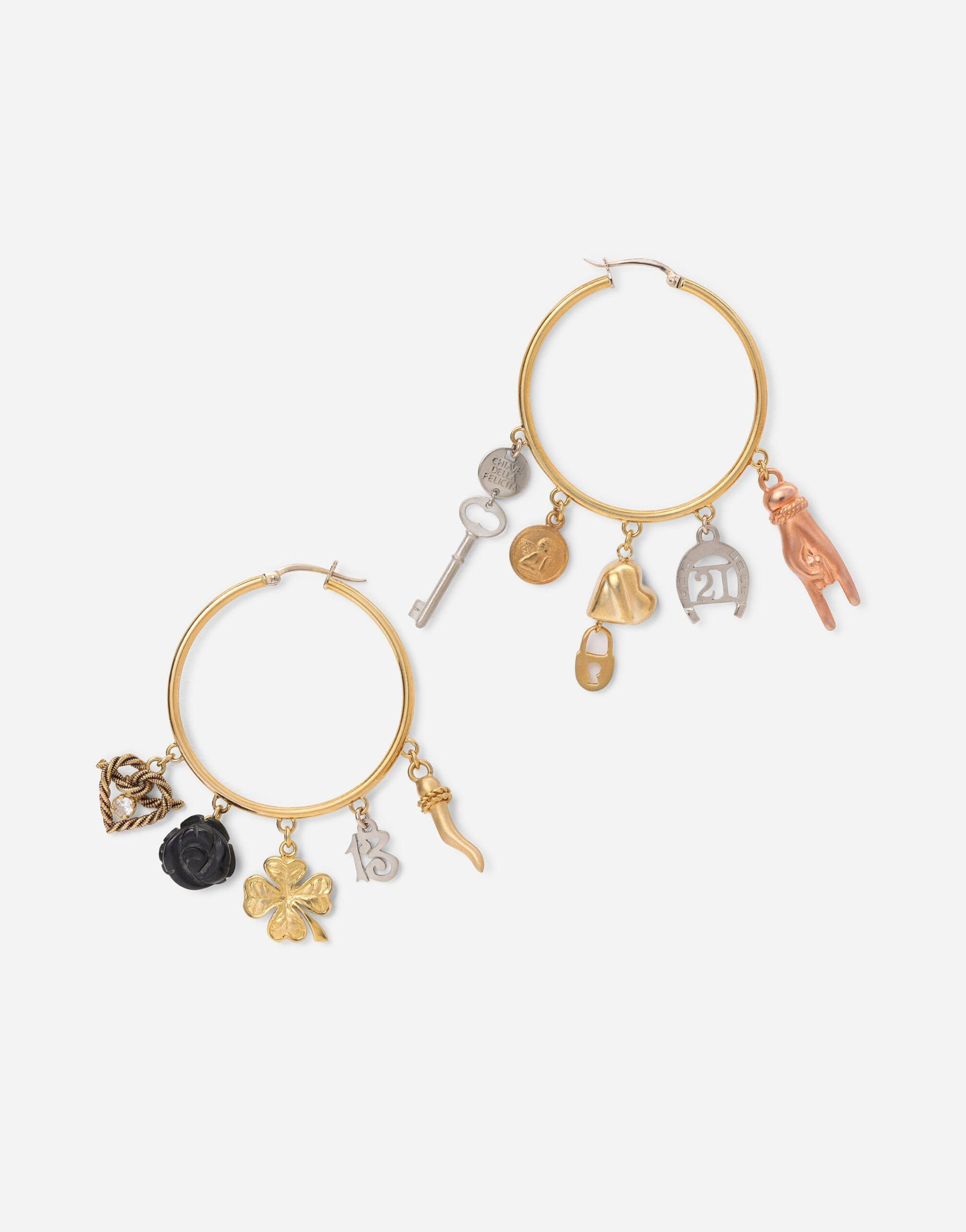 Good Luck earrings in 18kt yellow, white and red gold with lucky charms