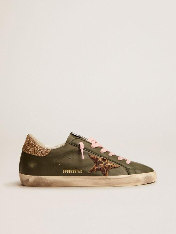 Super-Star sneakers in dark green leather with gold glitter heel tab