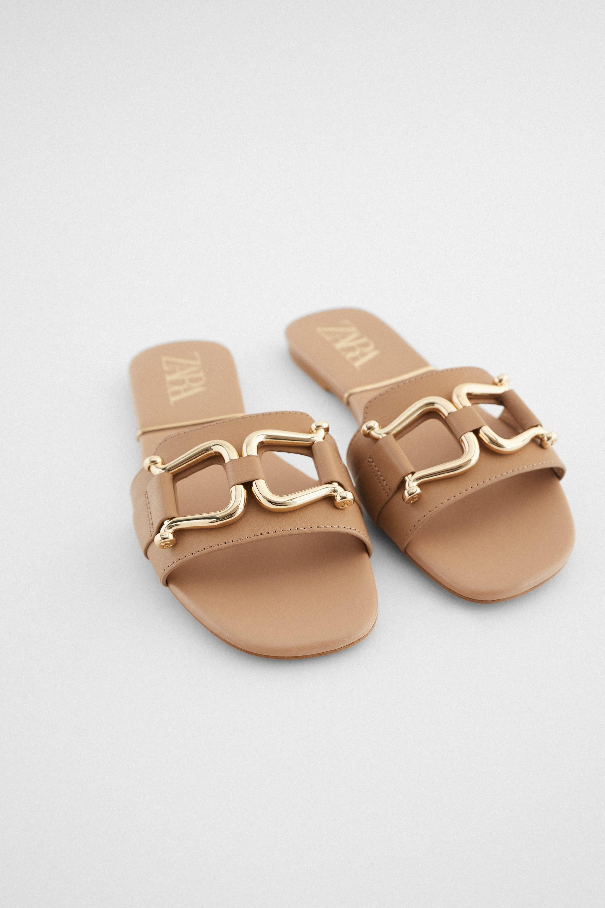 FLAT LEATHER SANDALS WITH GOLD SADDLE DETAIL 1