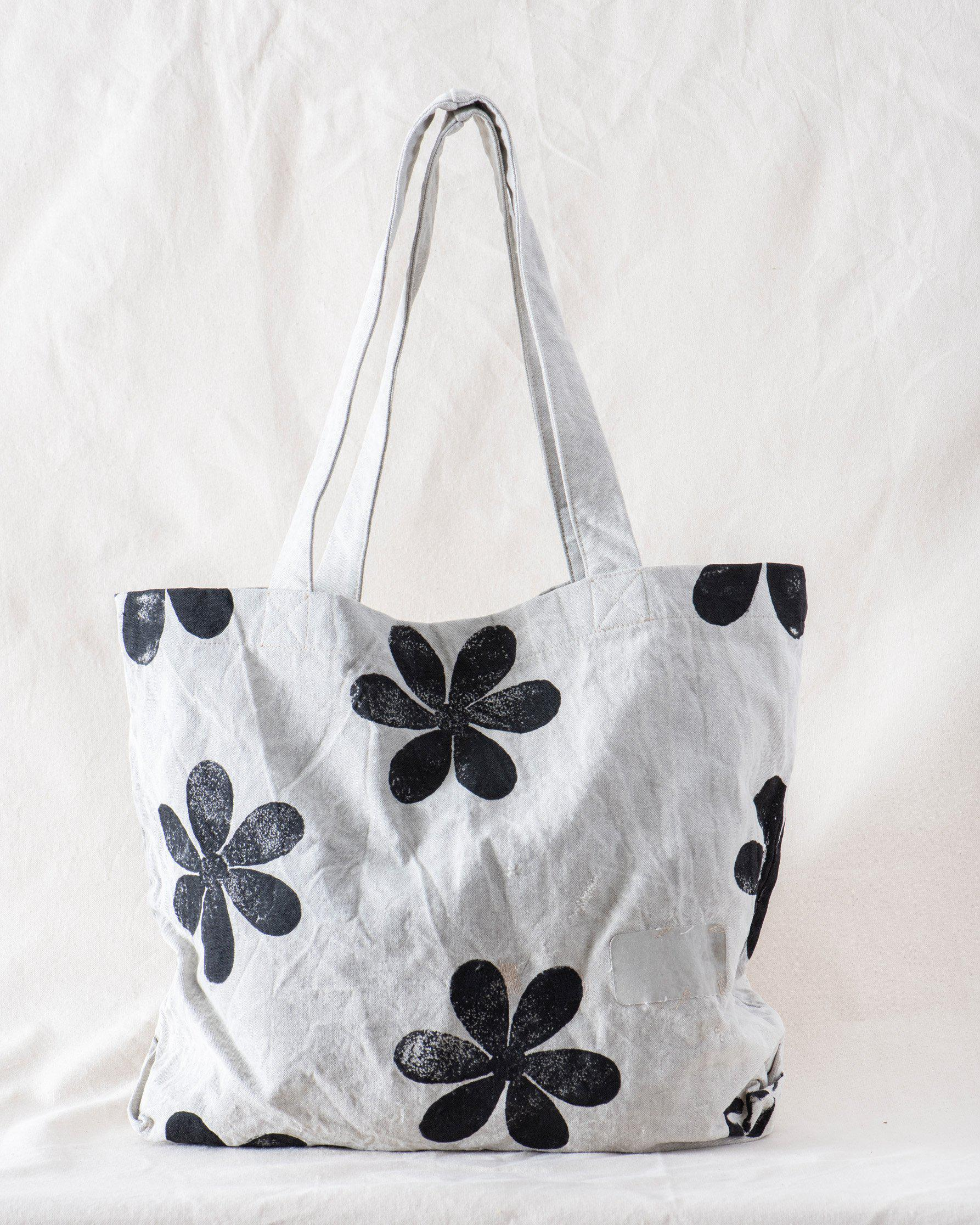 The Tote. -- Stone with Daisy Stamp