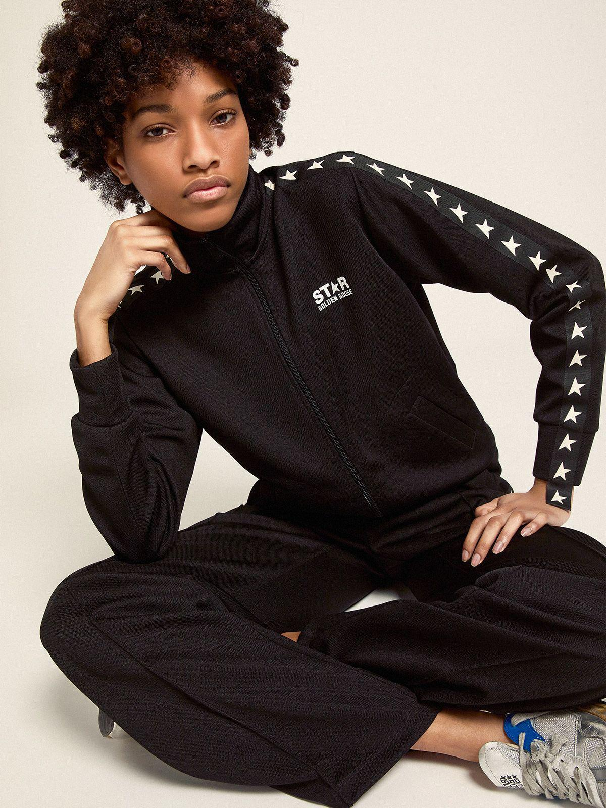Black Dorotea Star Collection jogging pants with white stars on the sides 2