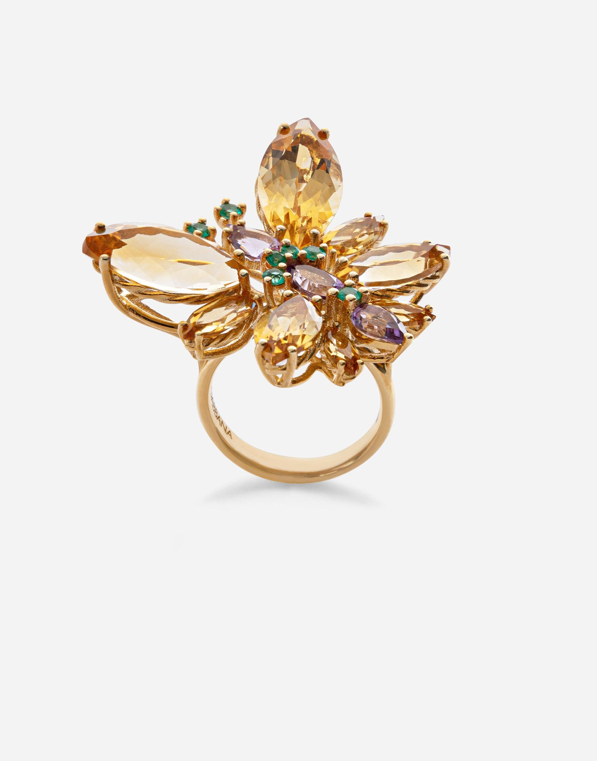 Spring ring in yellow 18kt gold with citrine butterfly