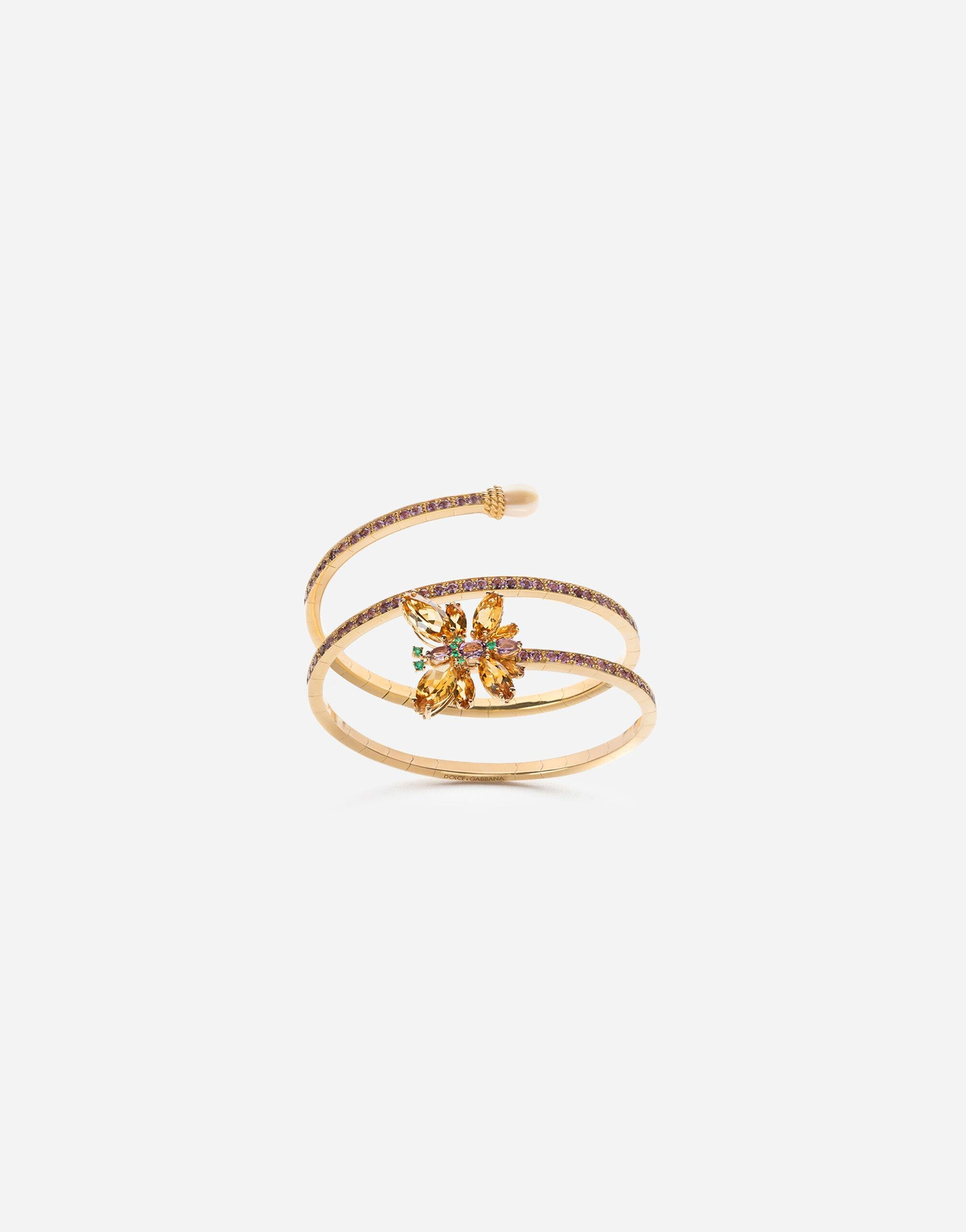 Spring yellow gold bracelet with butterfly-shaped settings