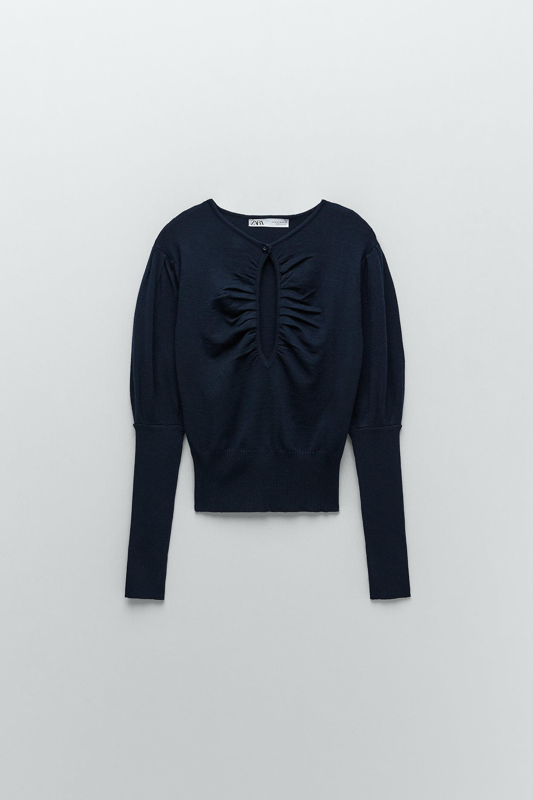 CUT OUT KNIT SWEATER 4