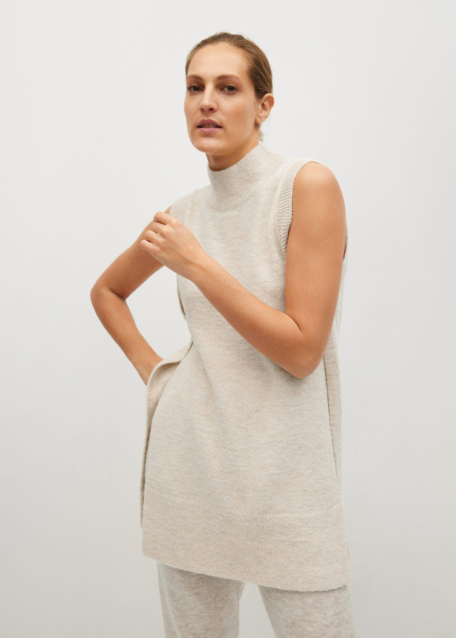 Long vest with openings