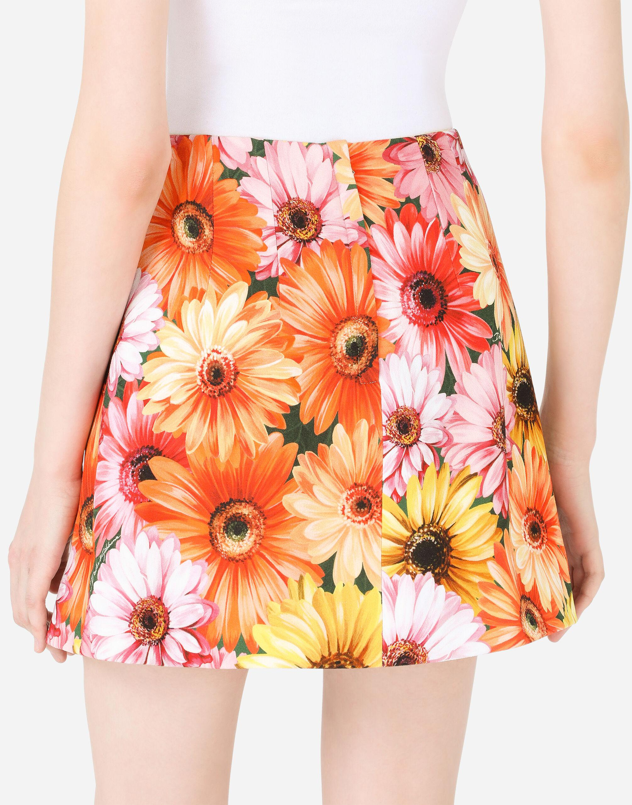 Cady miniskirt with gerbera-daisy print and decorative pearl DG buttons 3
