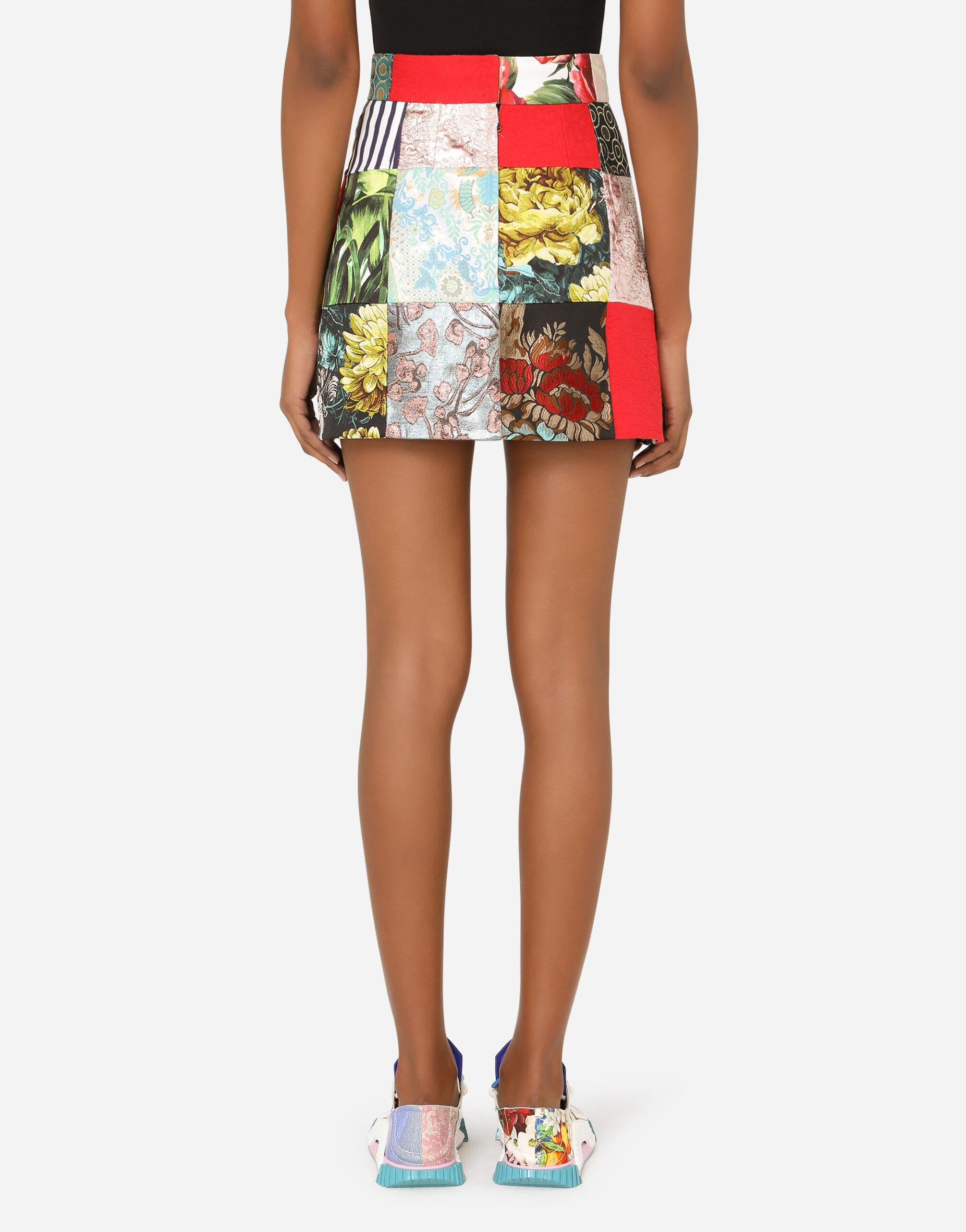 Patchwork jacquard miniskirt with bejeweled buttons 1