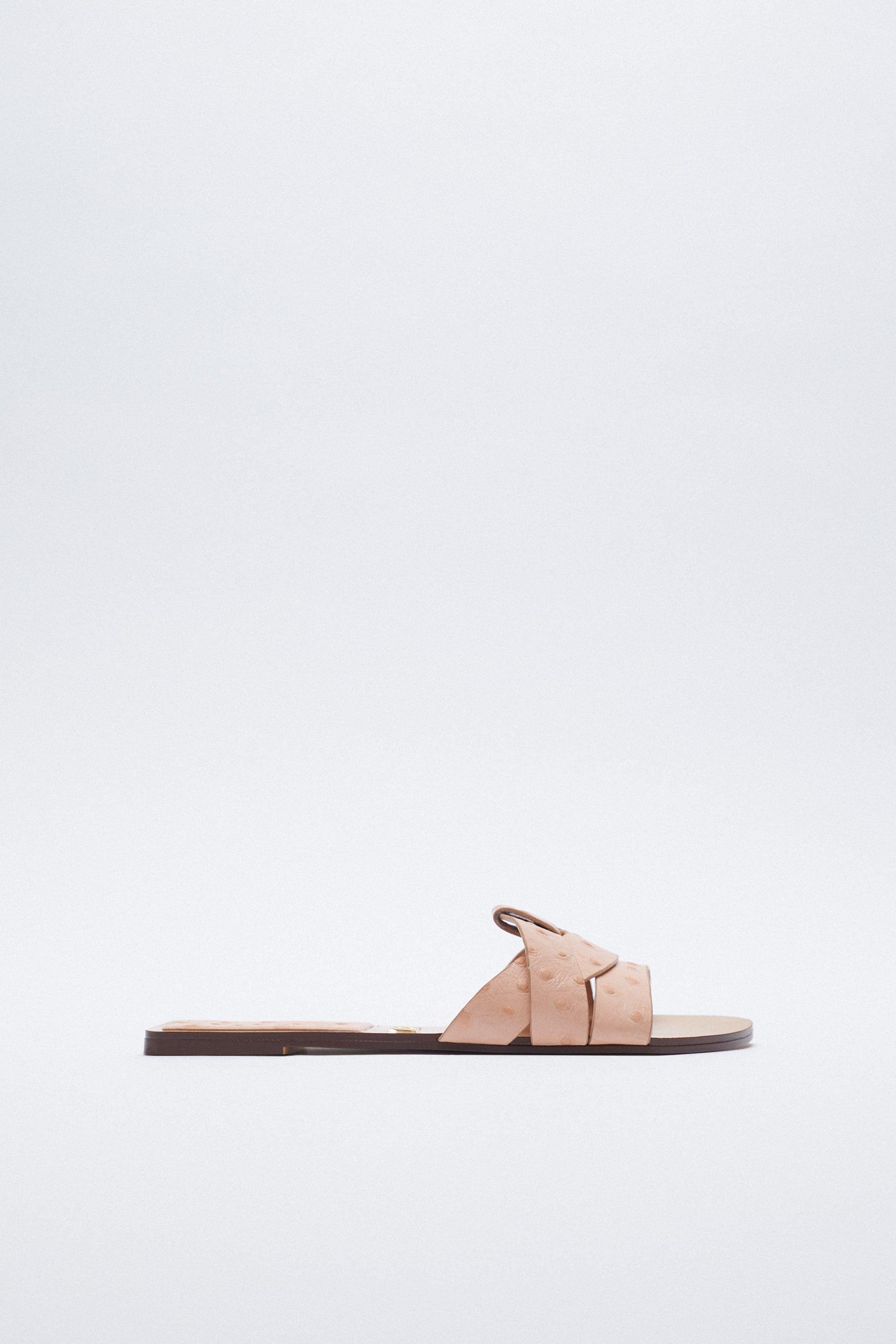 LOW HEELED CROSSED LEATHER SANDALS
