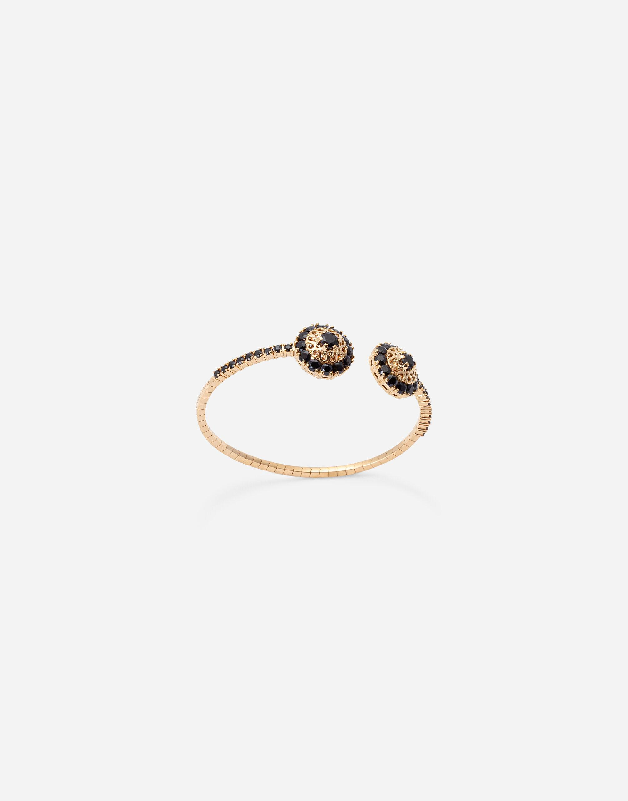 Family yellow gold bracelet with rosette motif and black sapphire