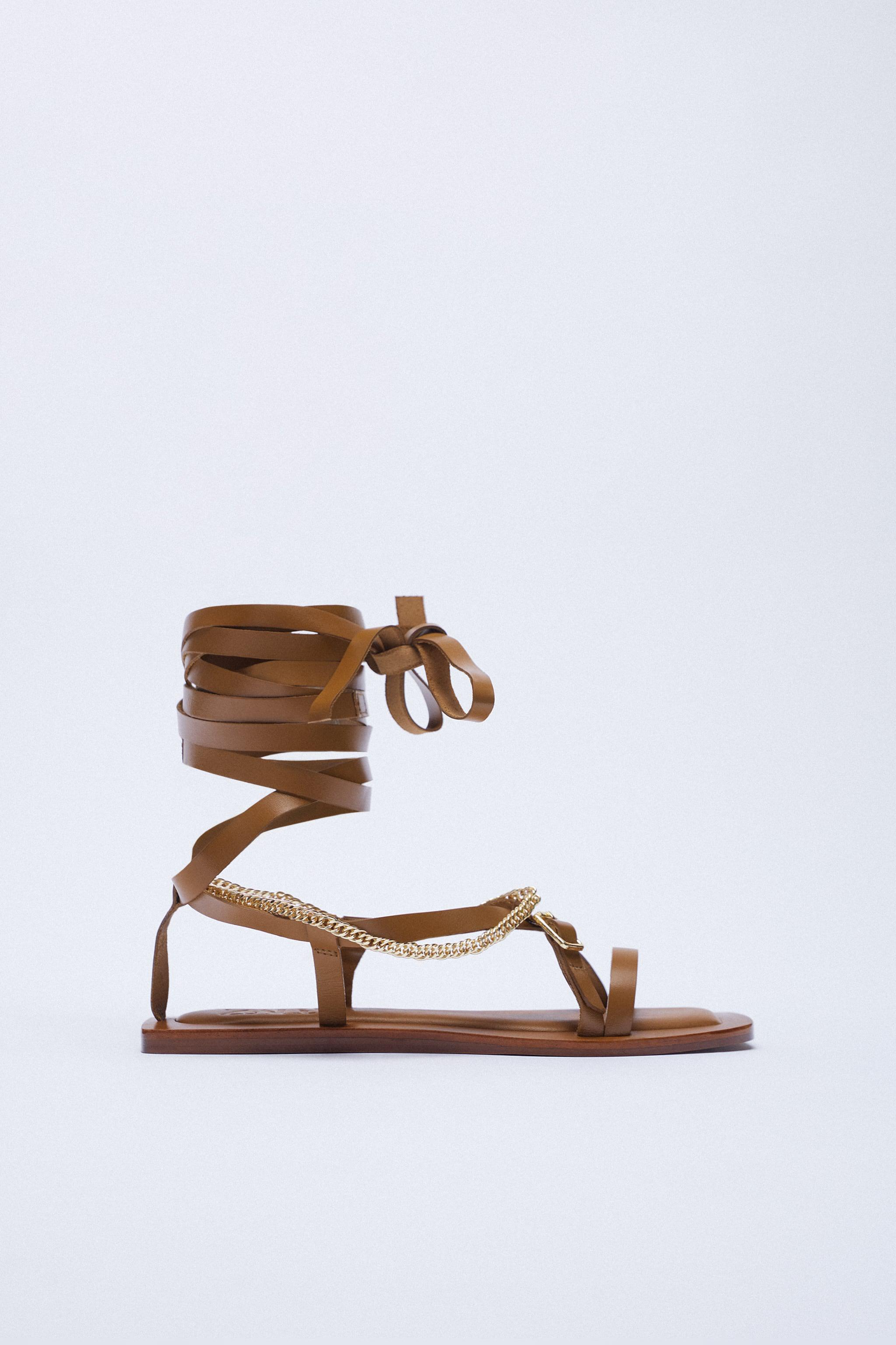 FLAT LEATHER SANDALS WITH TIED HEEL AND CHAIN 2