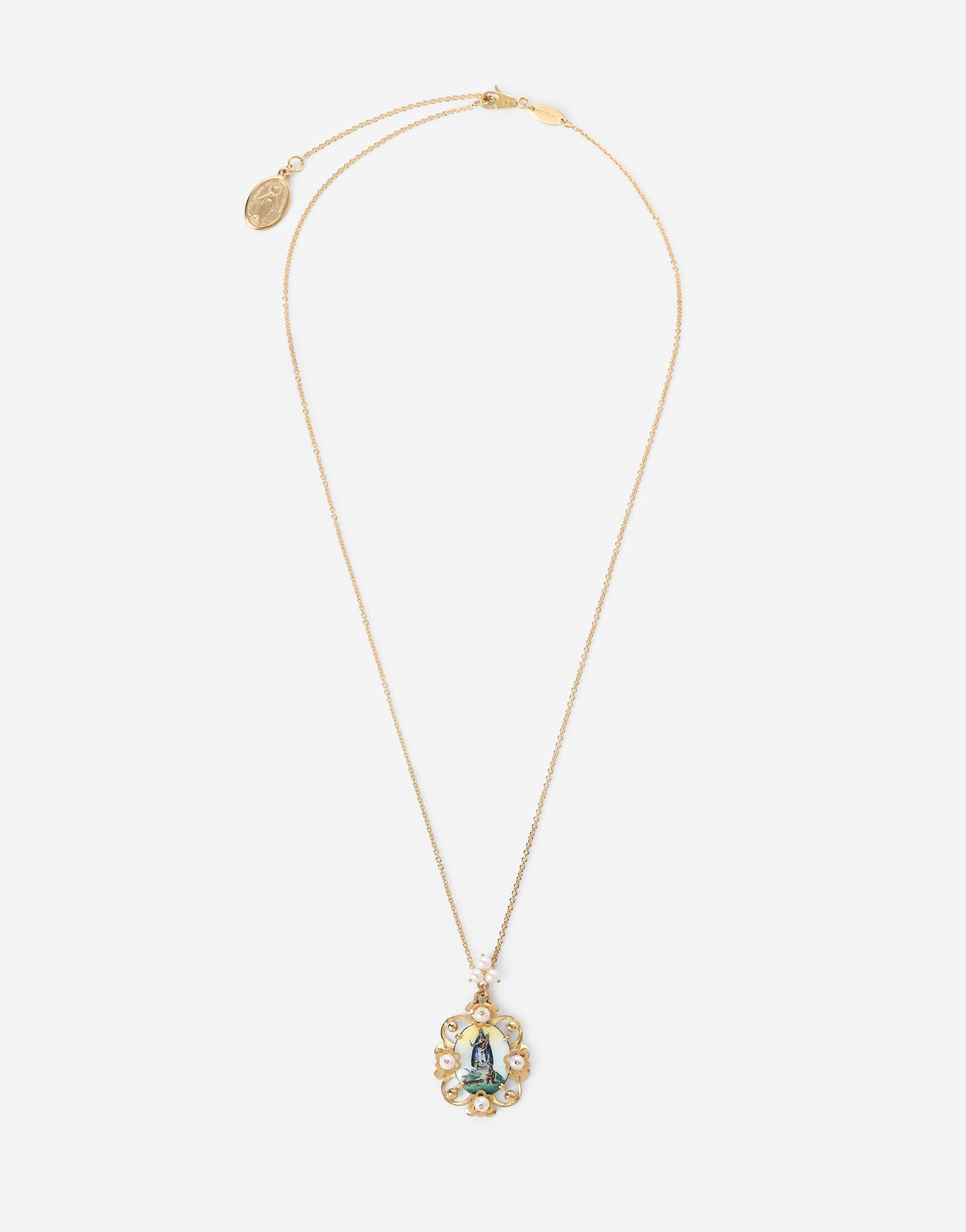 D.D. pendant in yellow 18kt gold and antique cheramic miniature
