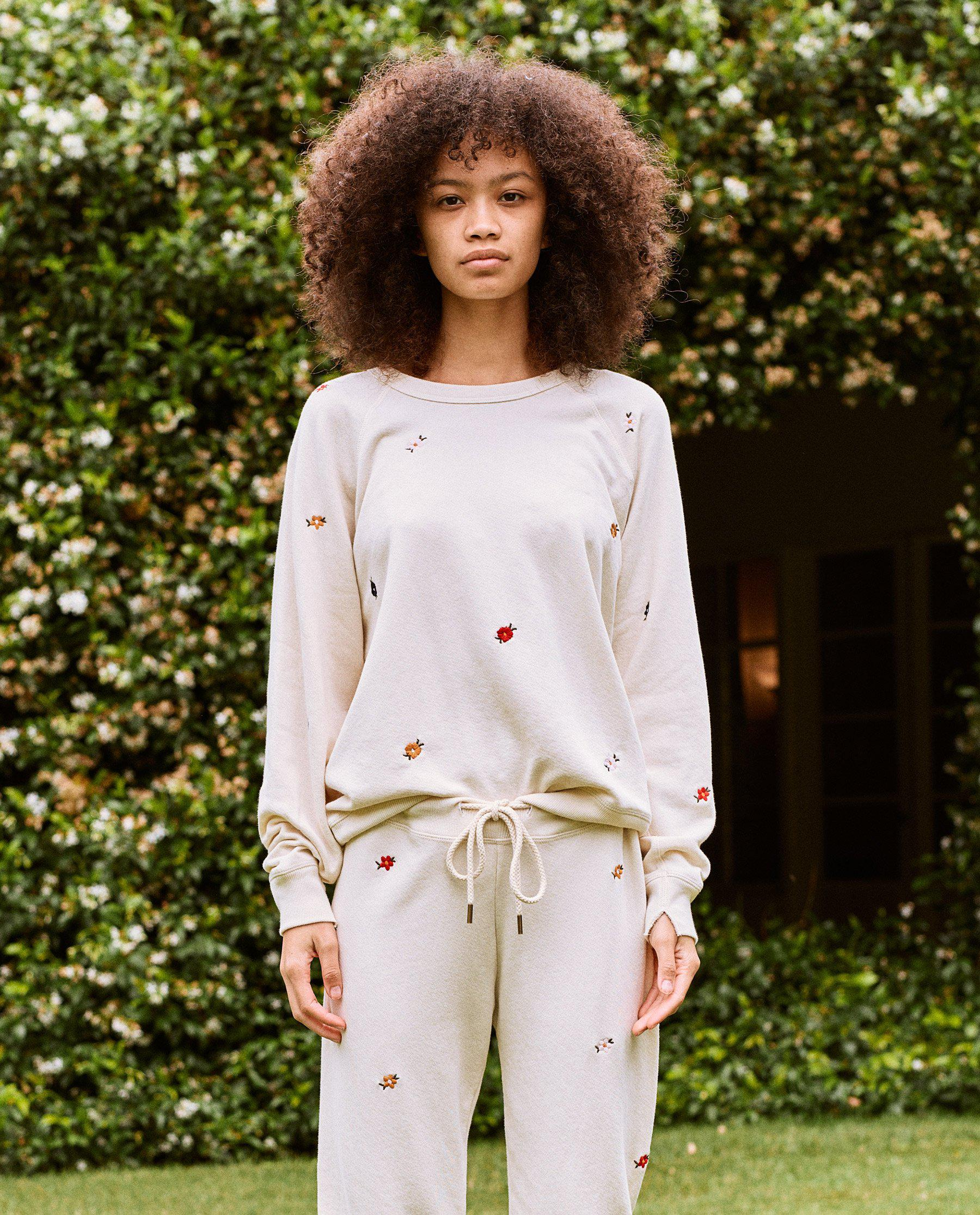 The College Sweatshirt. Embroidered -- Washed White with Seed Floral Embroidery