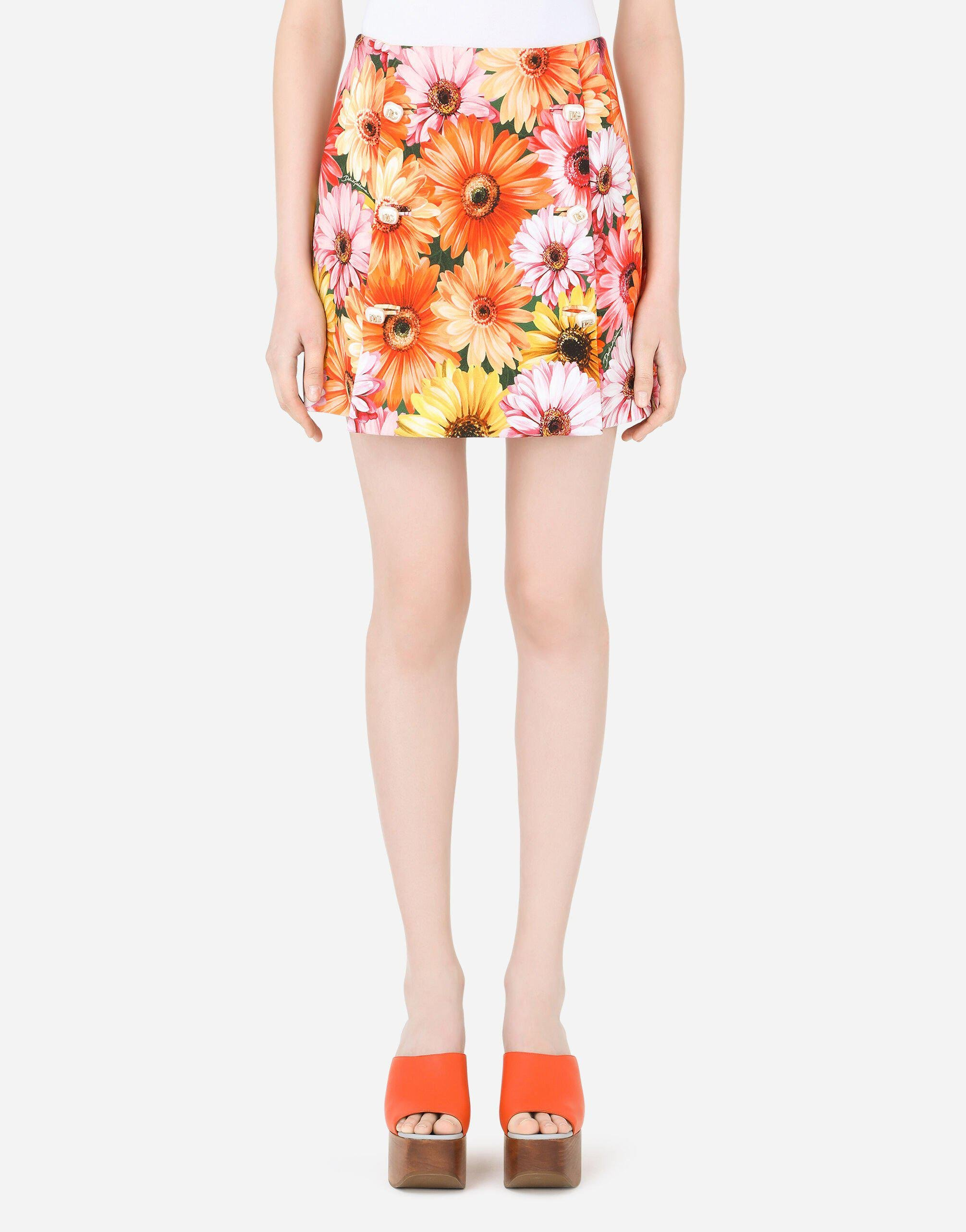 Cady miniskirt with gerbera-daisy print and decorative pearl DG buttons