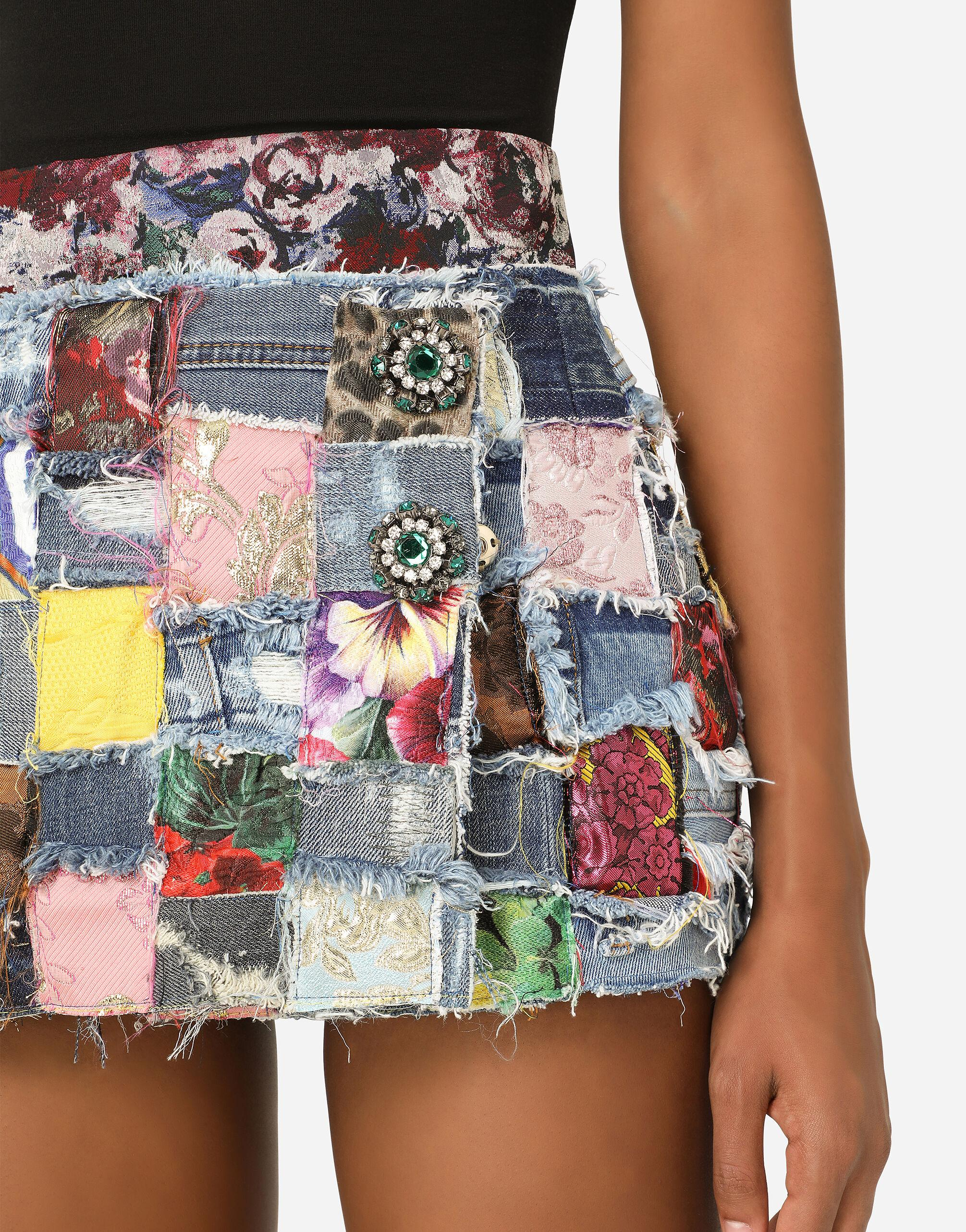 Denim miniskirt with interwoven patchwork detailing and bejeweled buttons 2