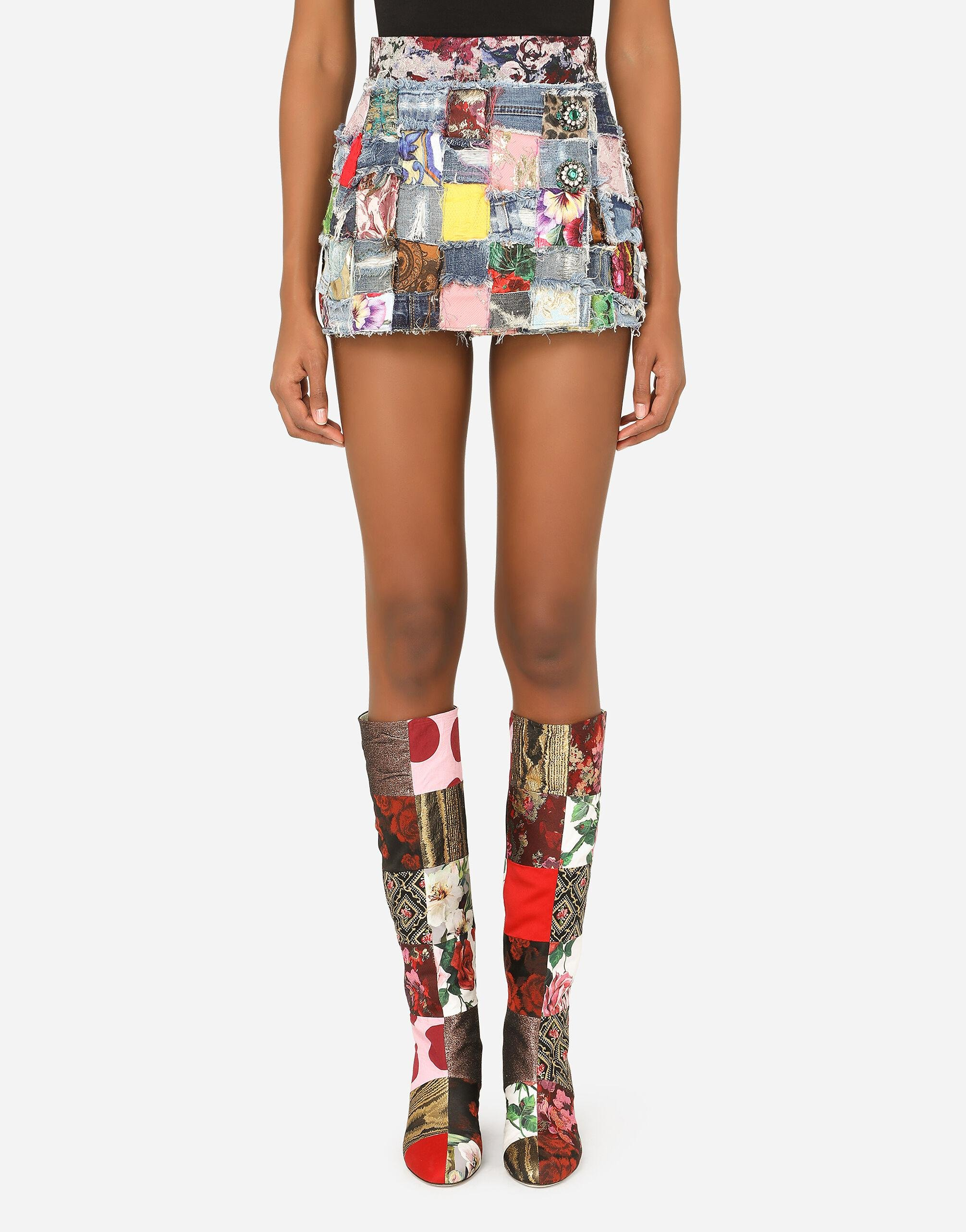 Denim miniskirt with interwoven patchwork detailing and bejeweled buttons