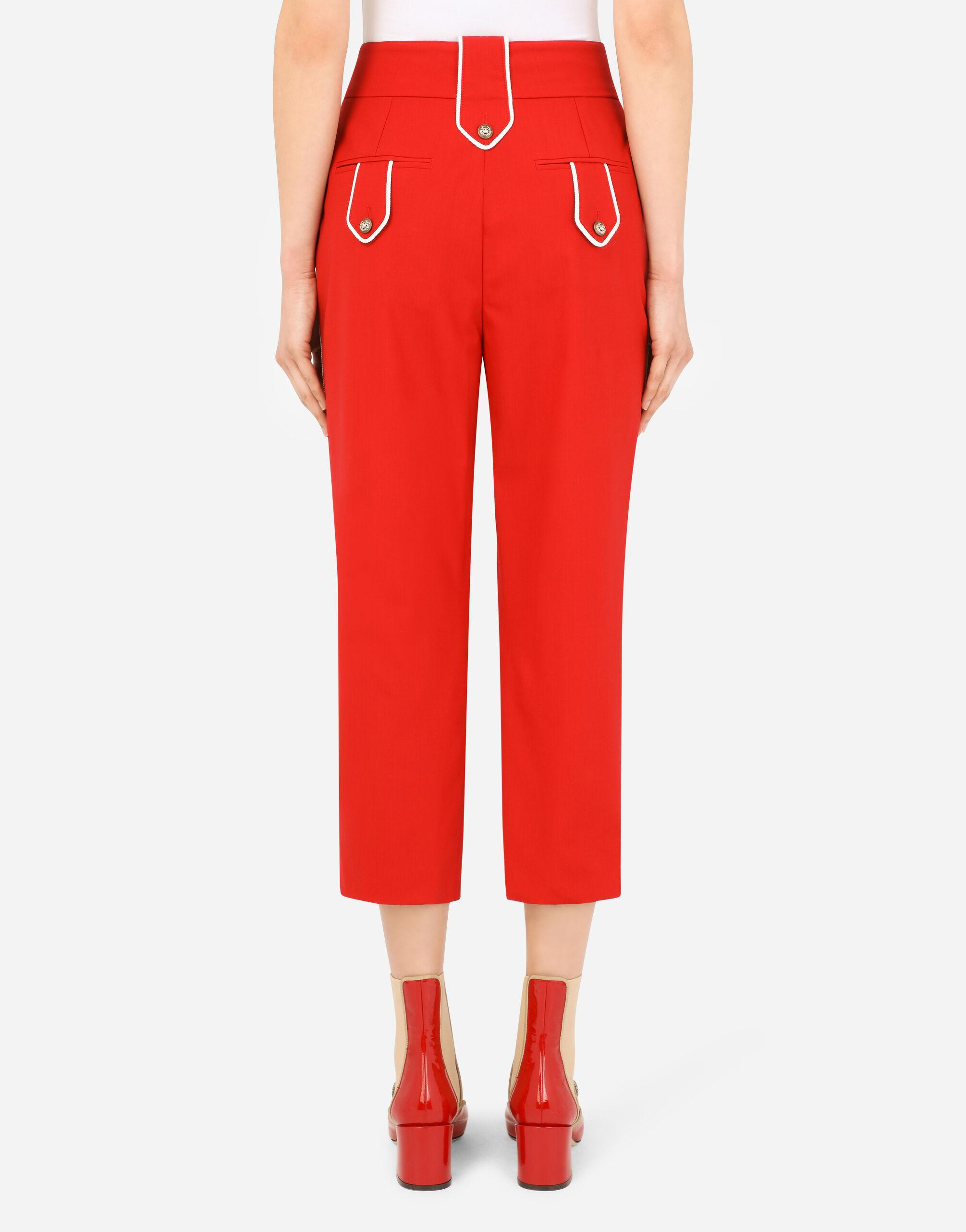 High-waisted woolen pants with heraldic buttons 1