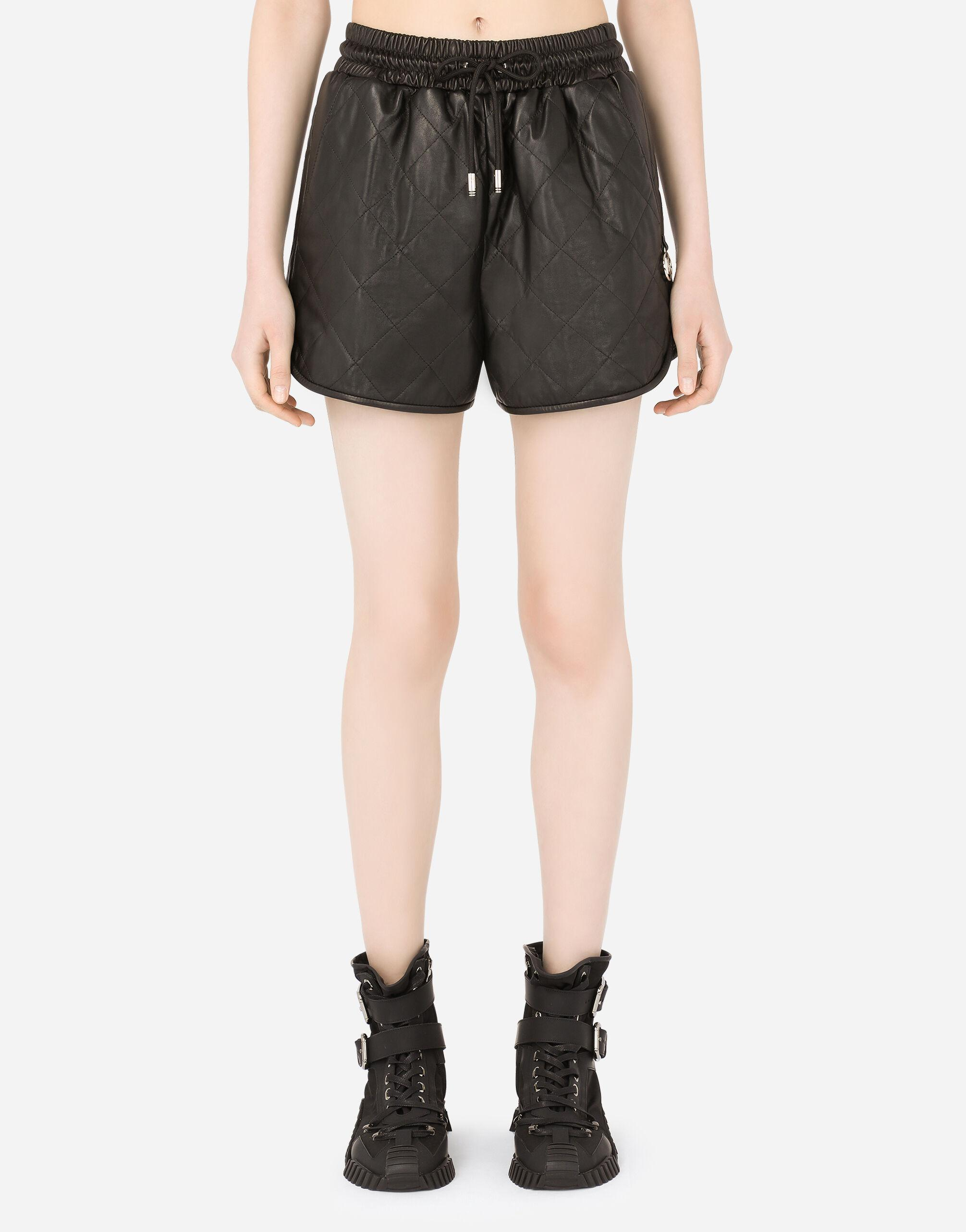 Quilted leather shorts with DG pendant
