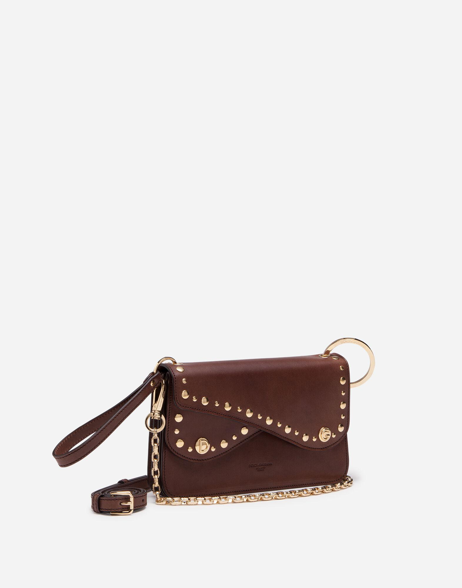 Biker bag in cowhide with embroidered studs 1