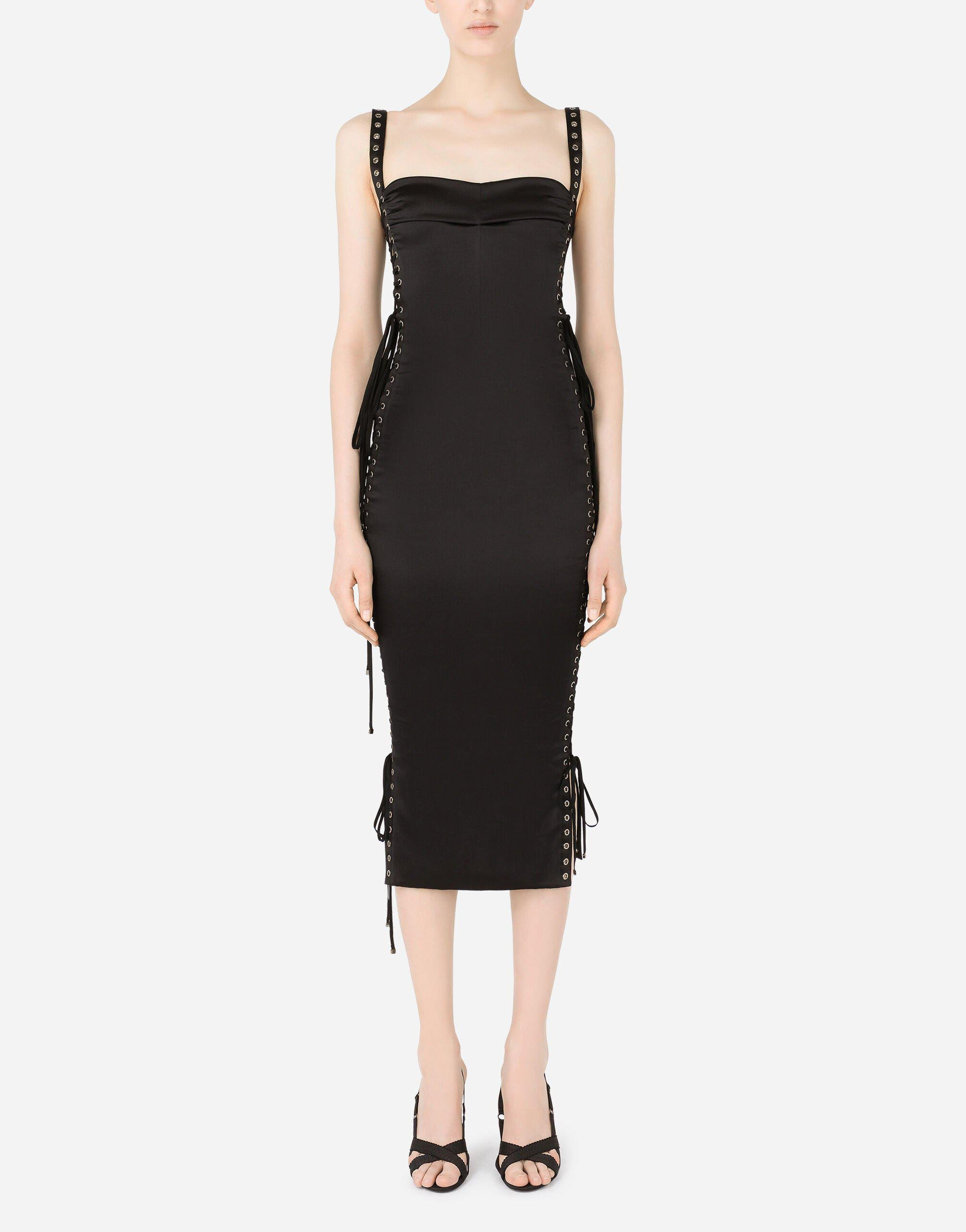 Satin calf-length dress with laces and eyelets