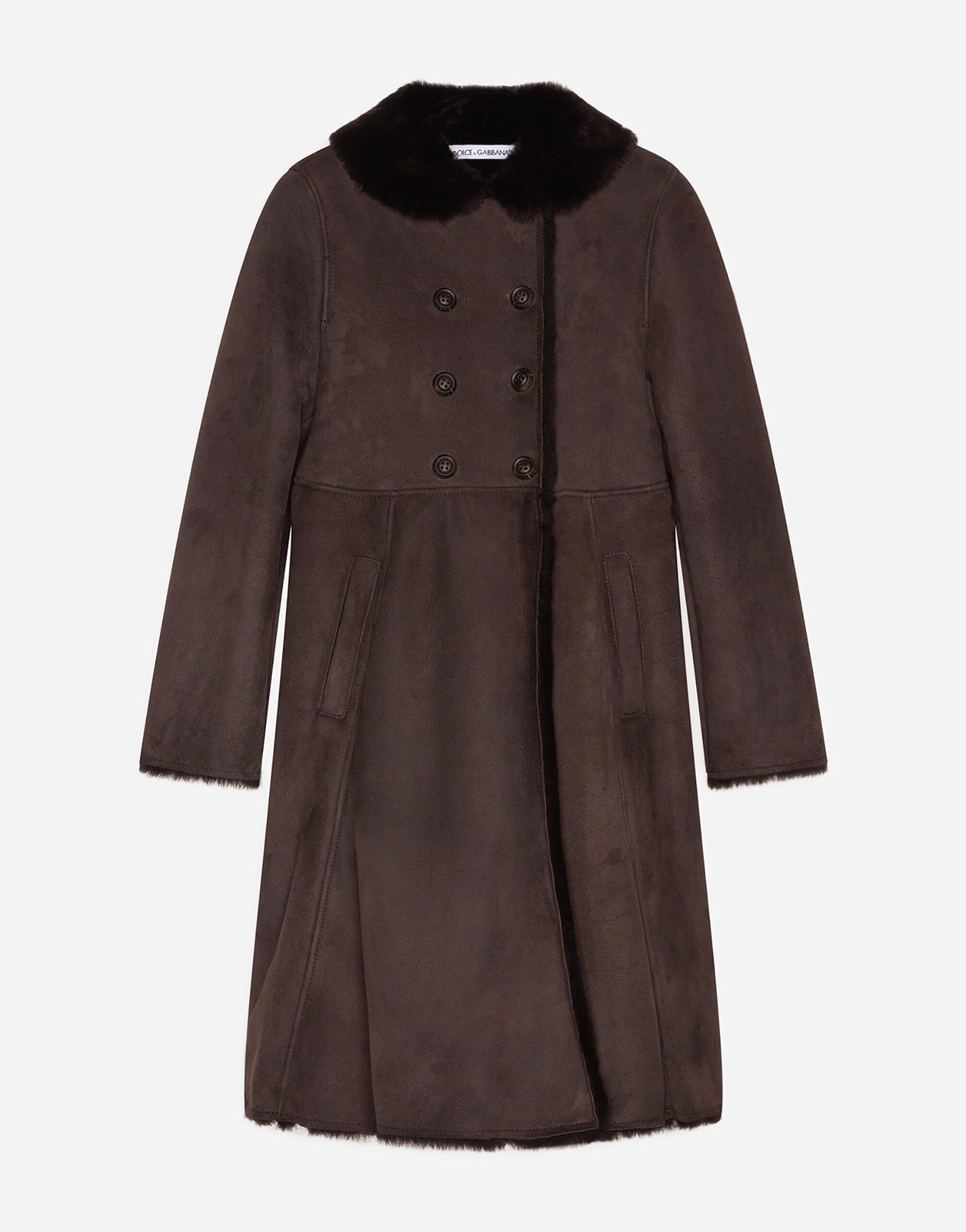 Double-breasted shearling coat with decorative buttons