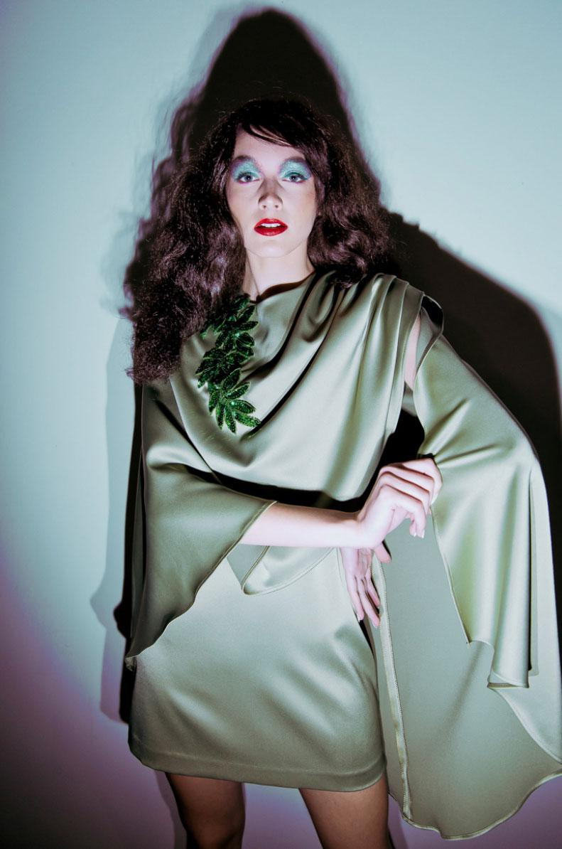 Green satin cape, pleated detail on shoulder