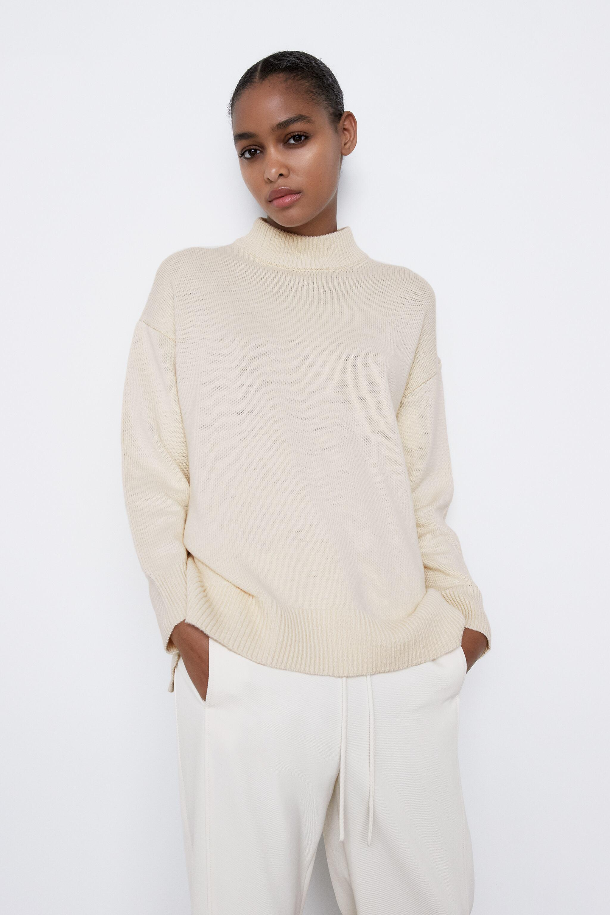 KNIT SWEATER WITH BACK OPENING 2