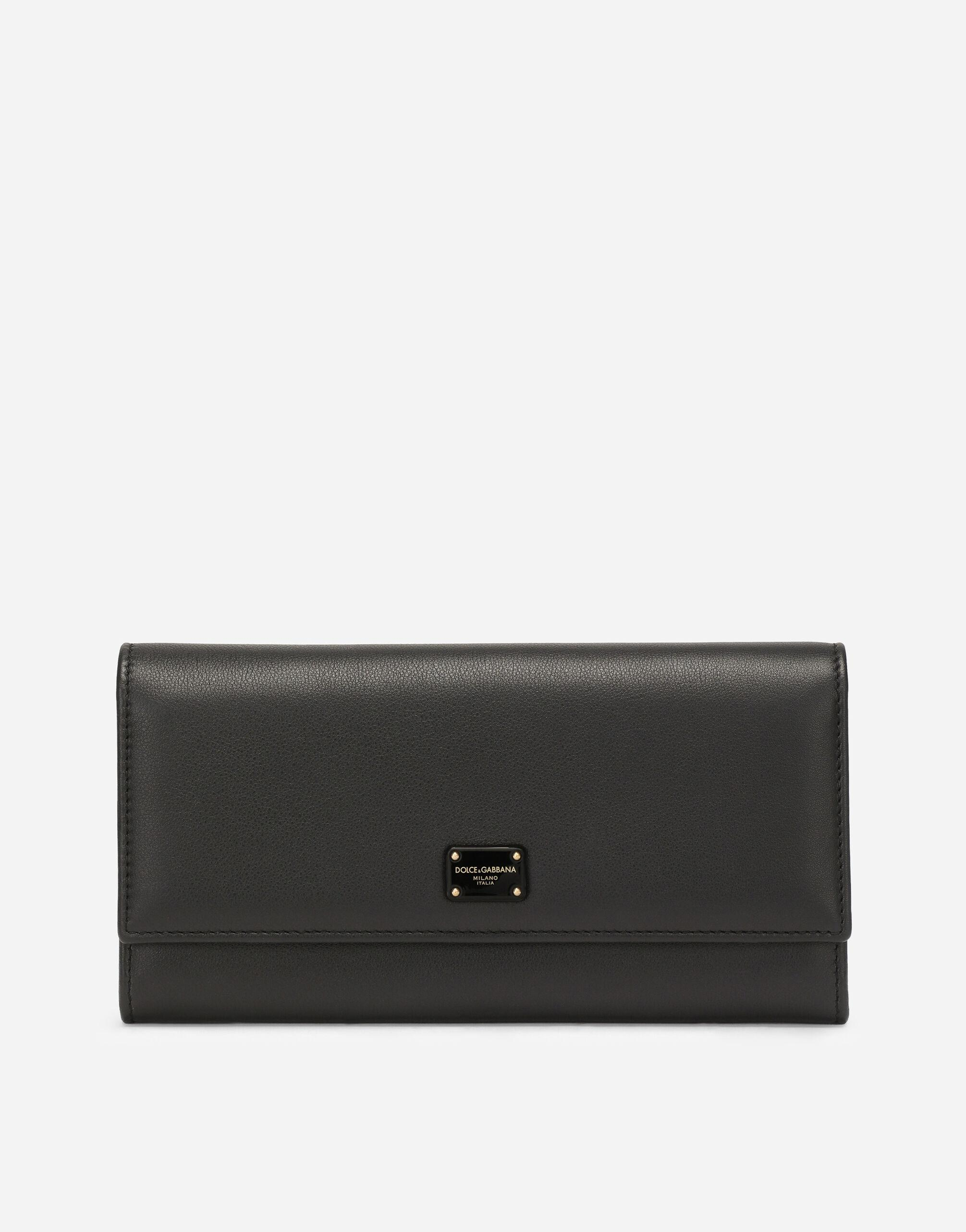 Calfskin continental wallet with branded plate