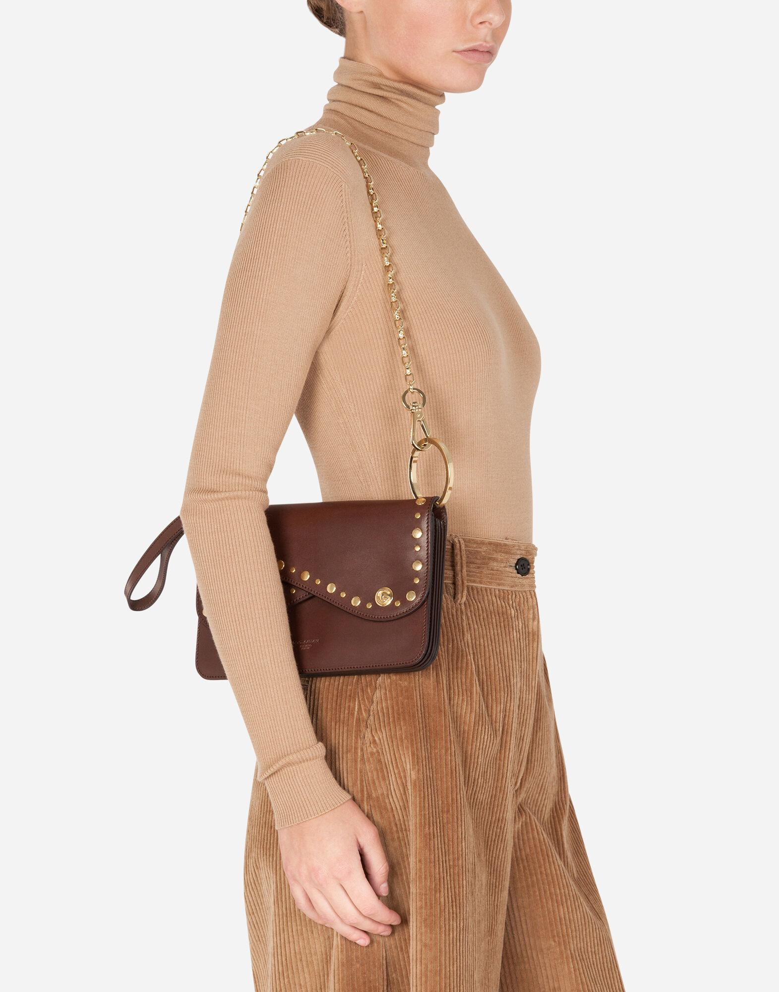 Biker bag in cowhide with embroidered studs 8