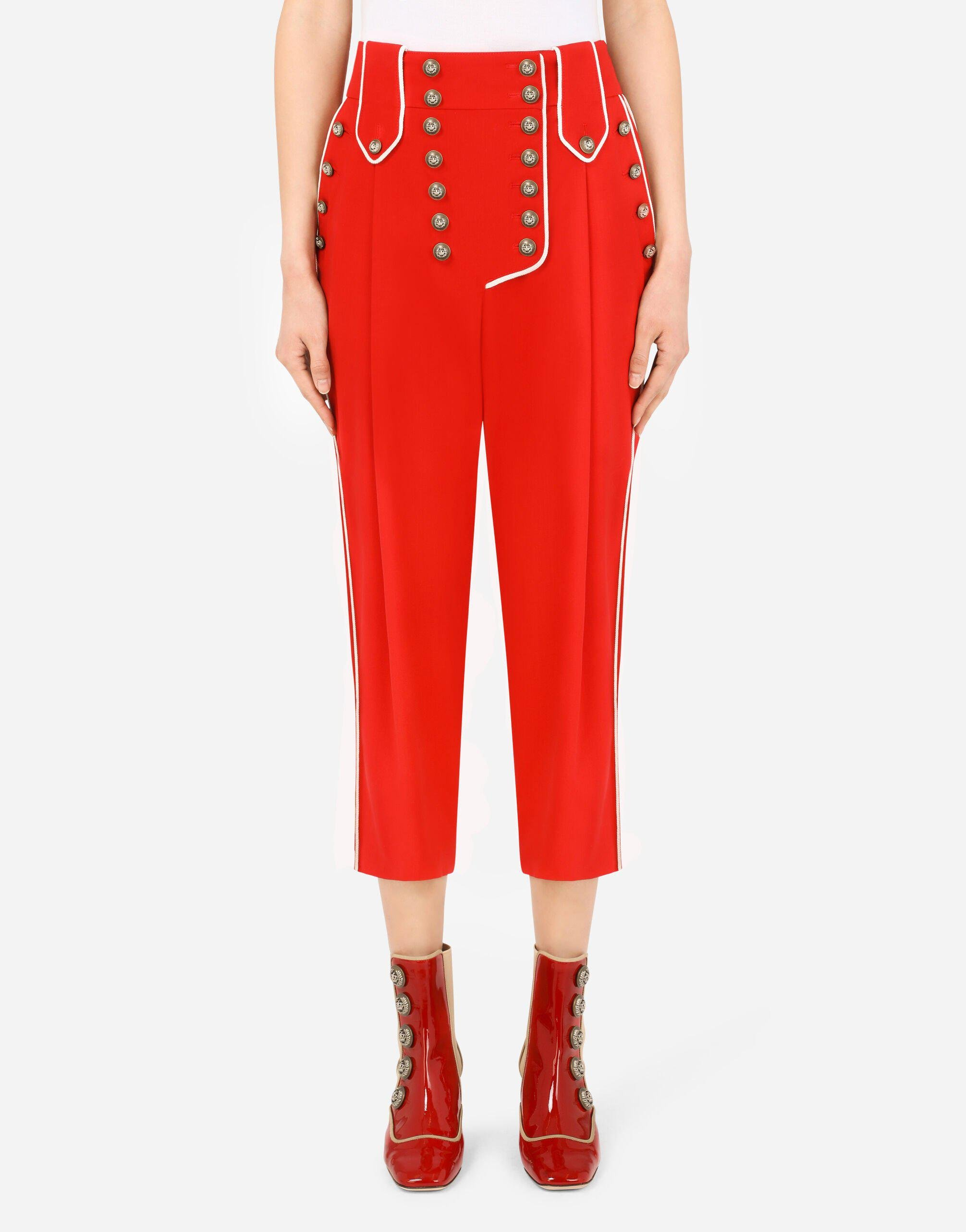 High-waisted woolen pants with heraldic buttons