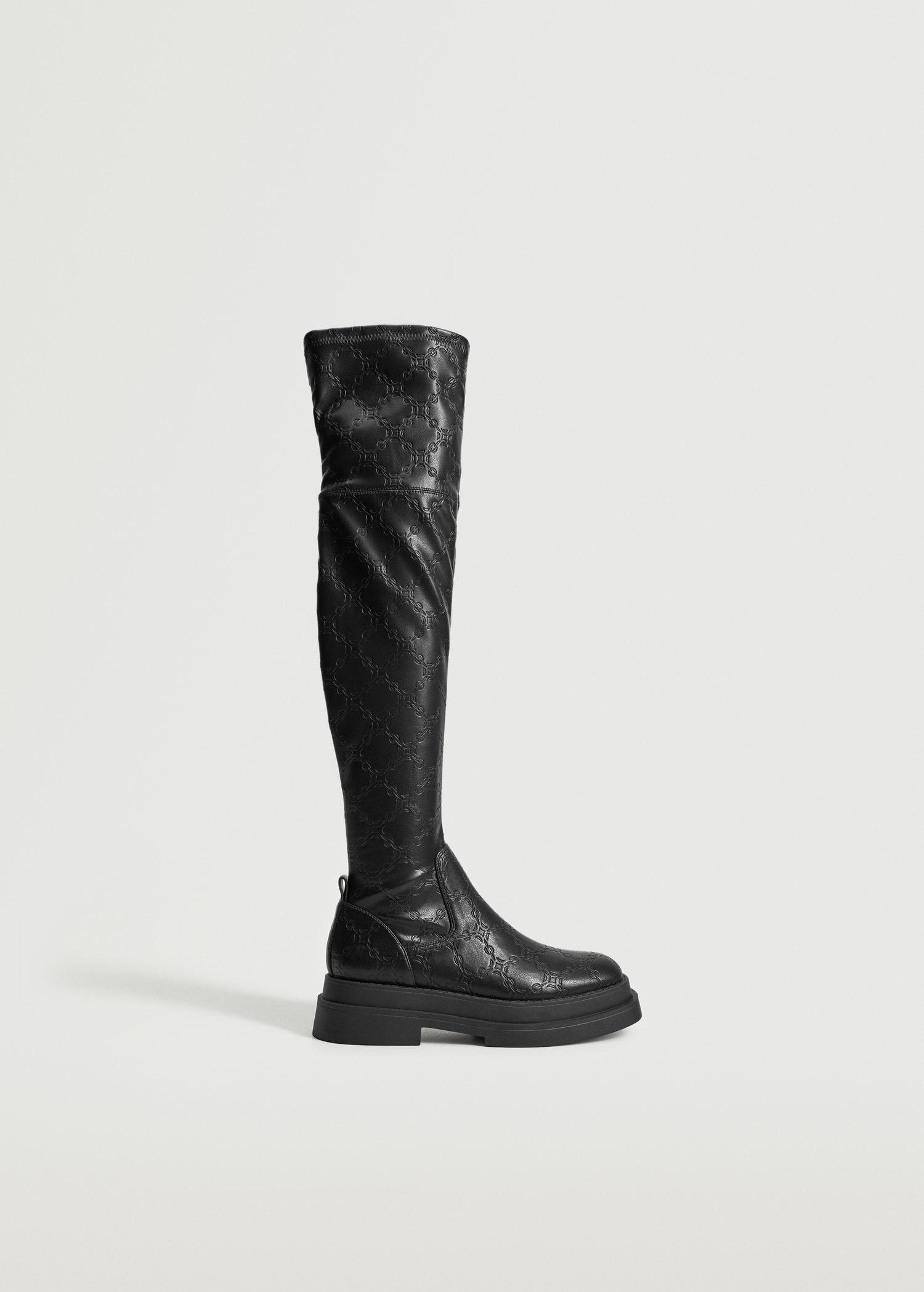High textured boots with chains
