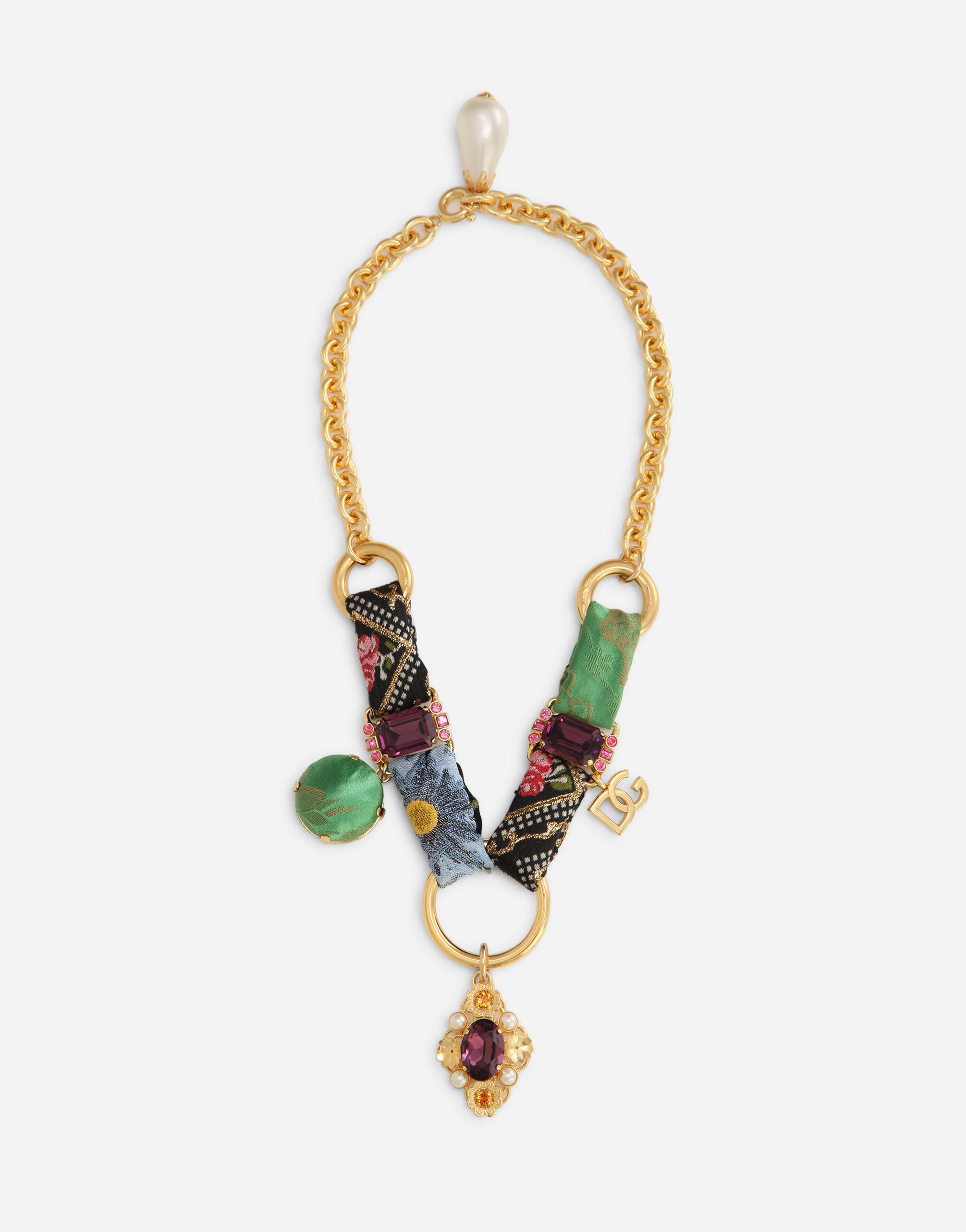 Short necklace with patchwork details and rhinestones