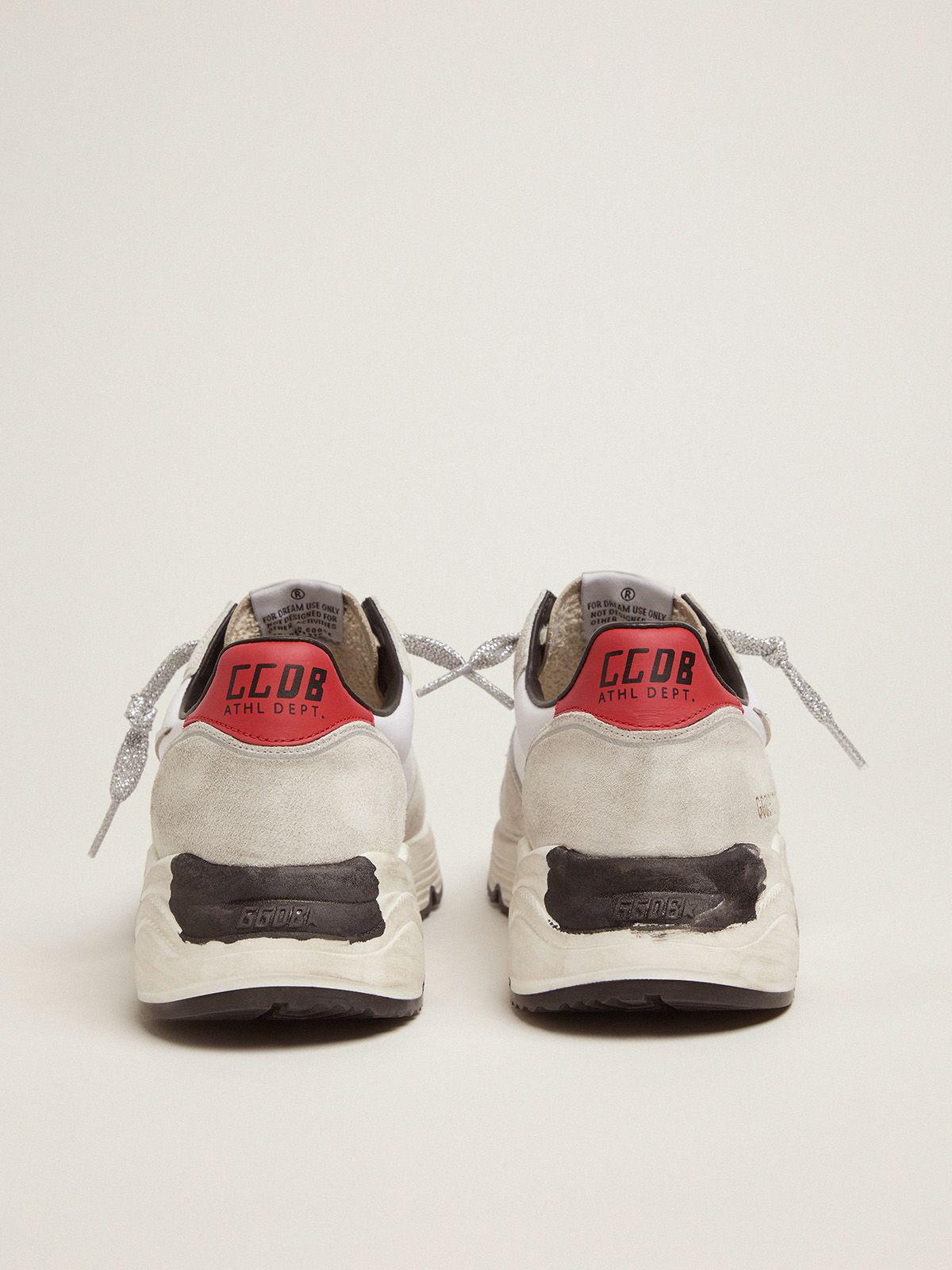Running Sole sneakers with red heel tab and silver star 3