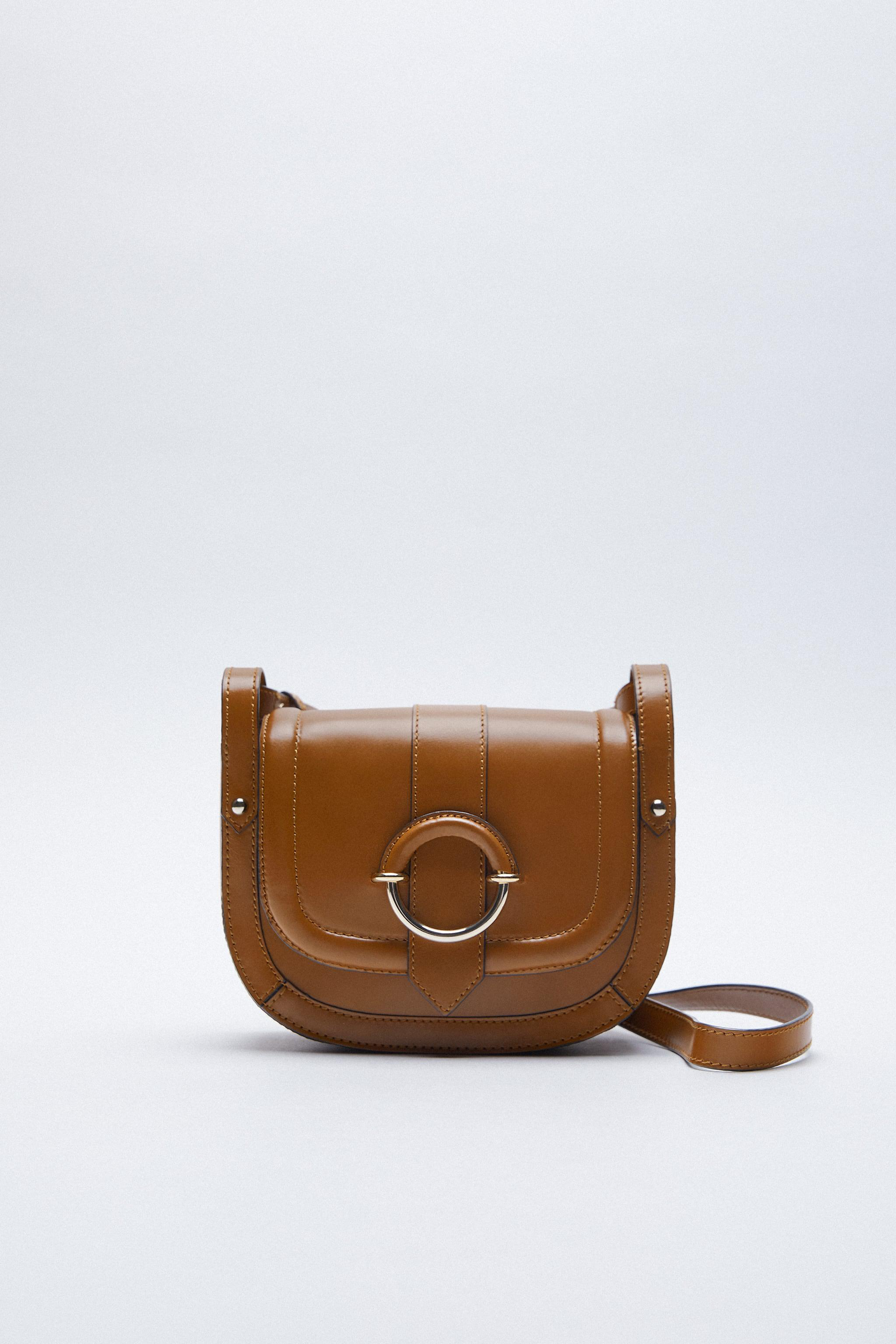 OVAL LEATHER CROSSBODY BAG WITH BUCKLE 1