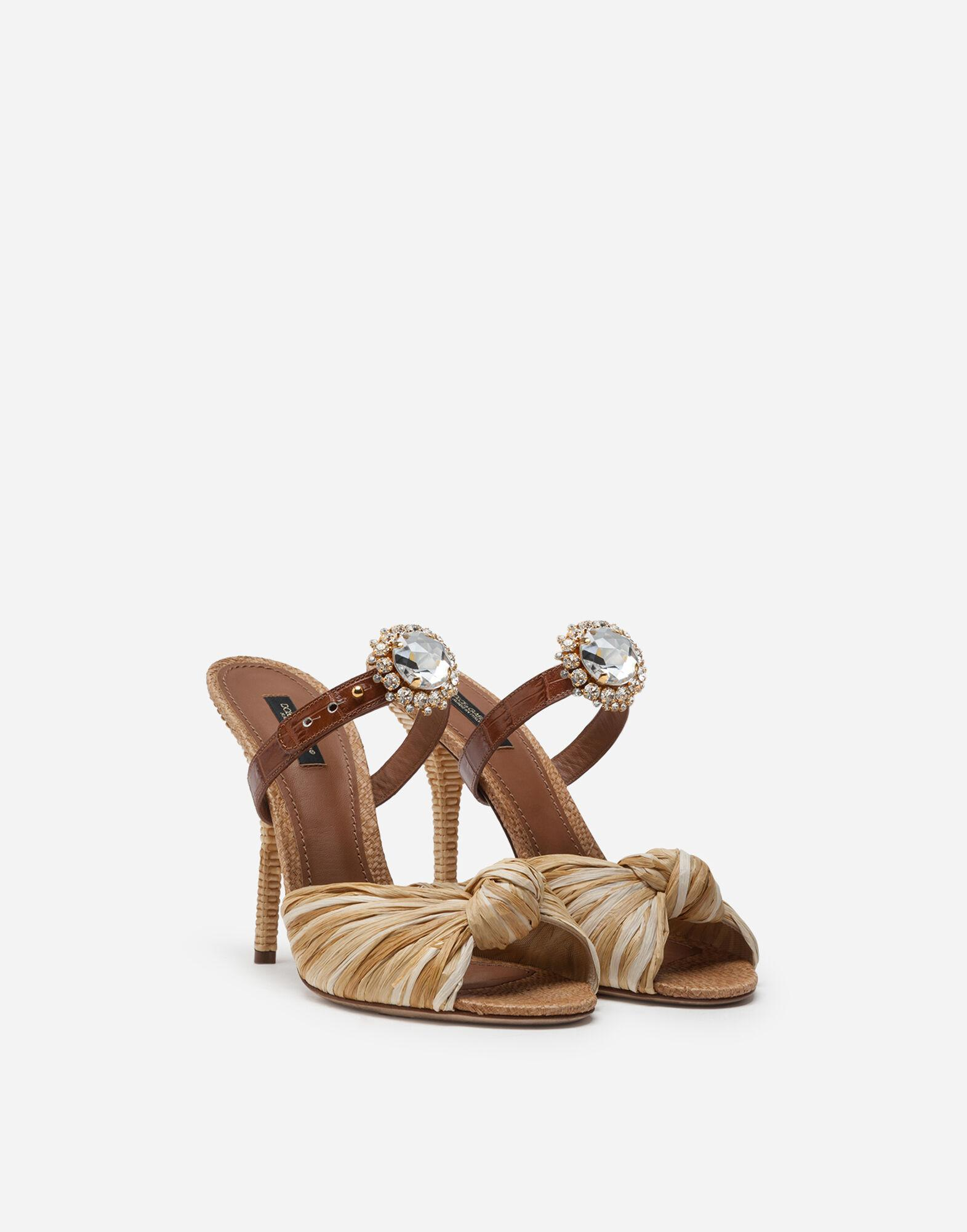 Mules in tropea straw and calfskin with bejeweled buckle 1