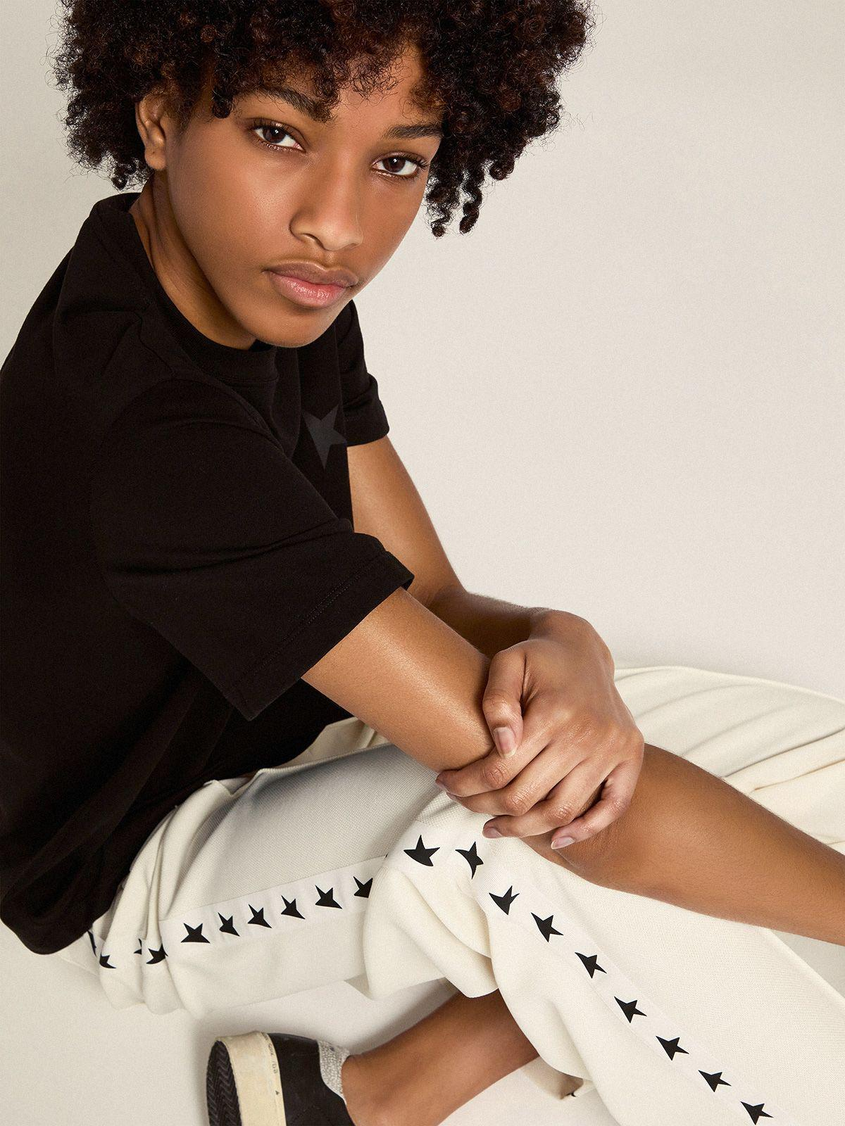 Papyrus white Dorotea Star Collection jogging pants with black stars on the sides 1