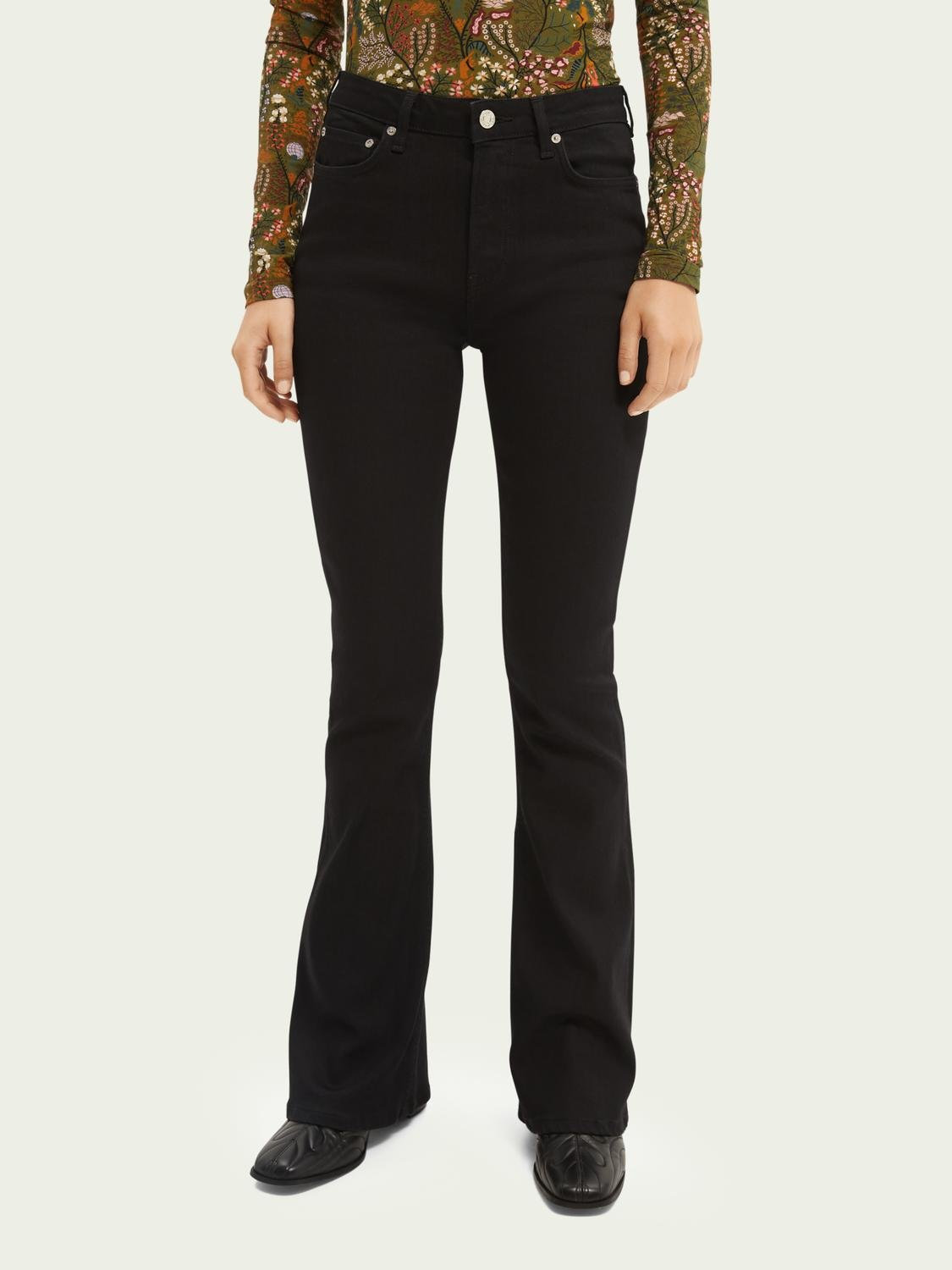 The Charm high-rise flared jeans —Think Different