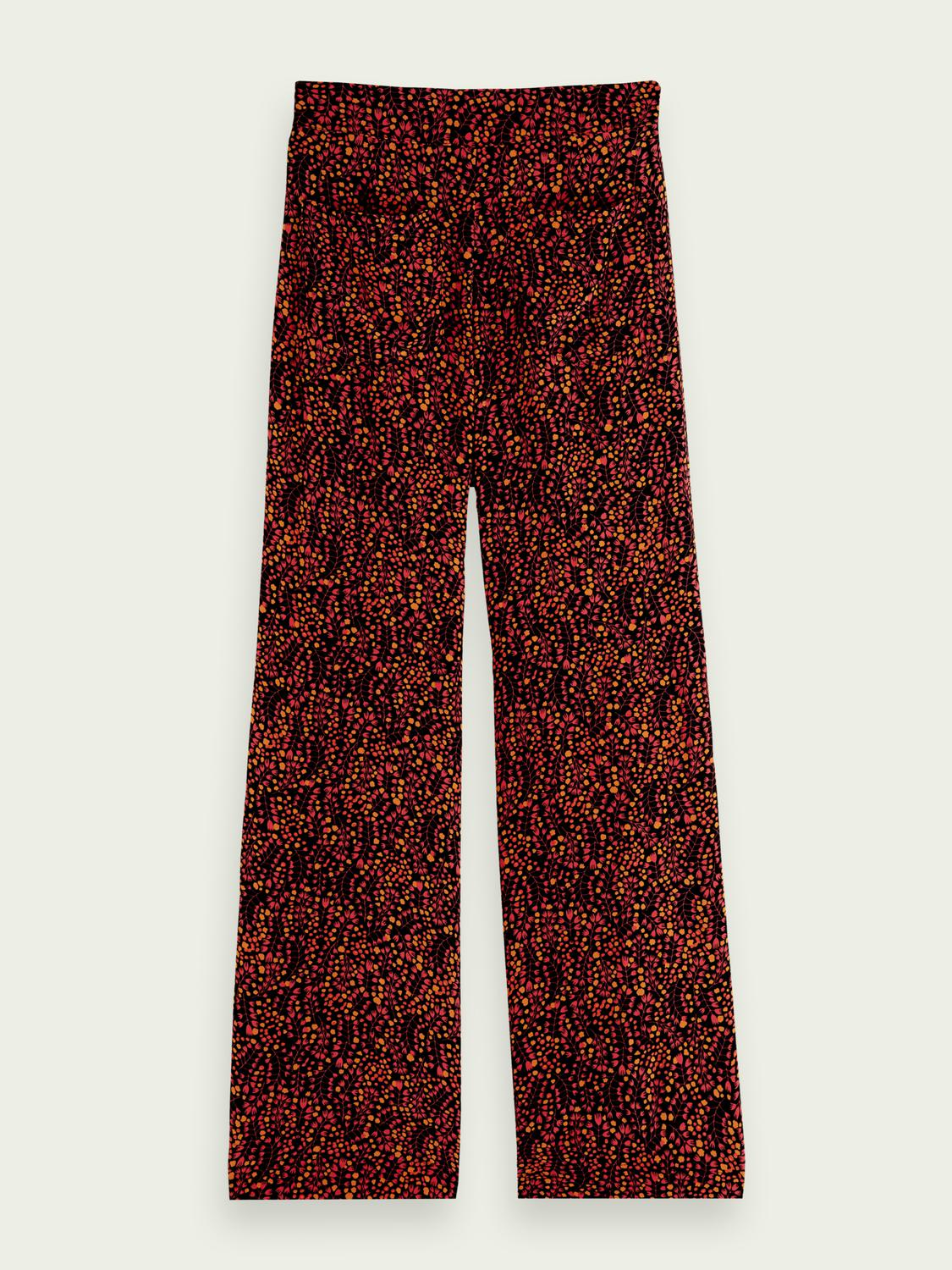 Printed mid-rise trousers 7