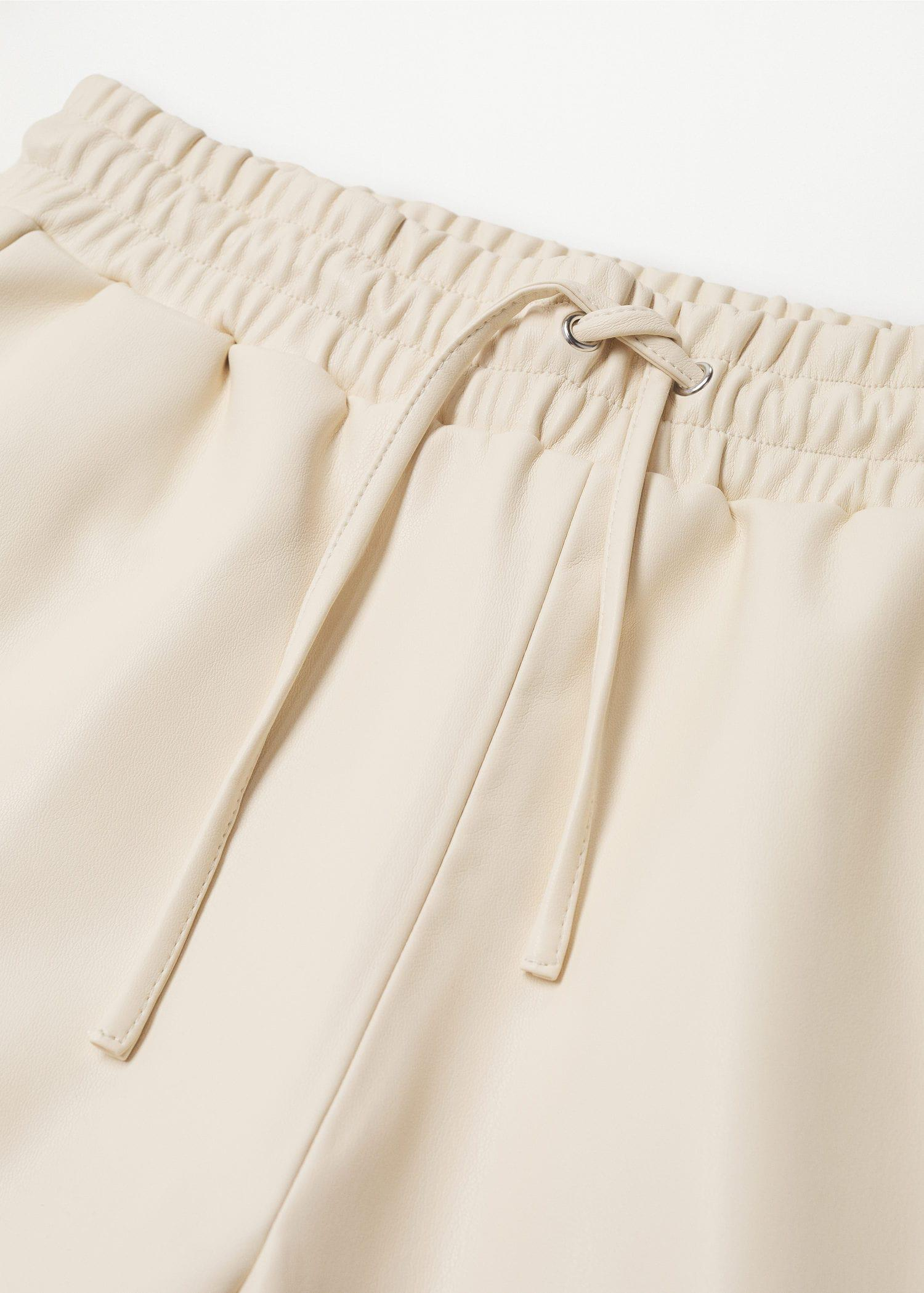 Leather-effect elastic waist trousers 6