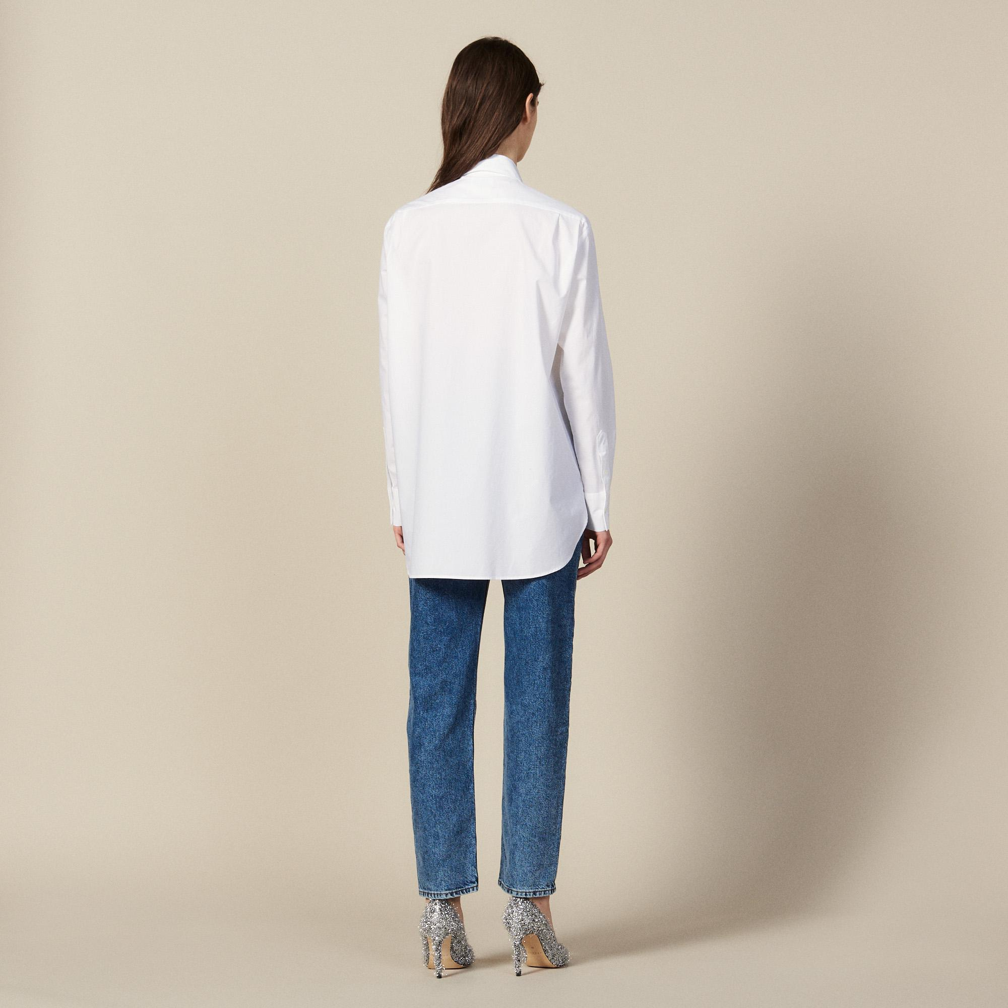 Asymmetric shirt trimmed with studs