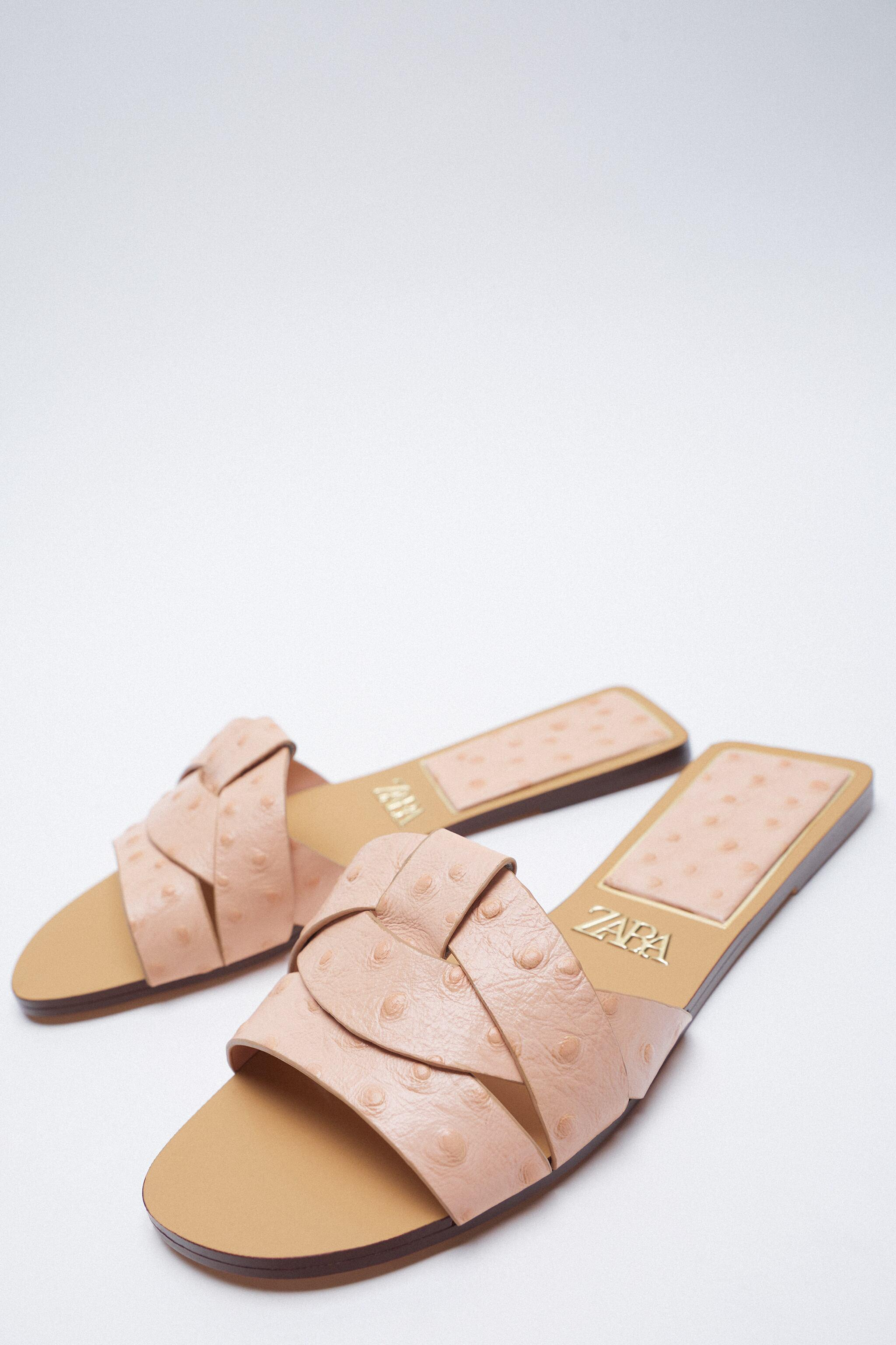 LOW HEELED CROSSED LEATHER SANDALS 2