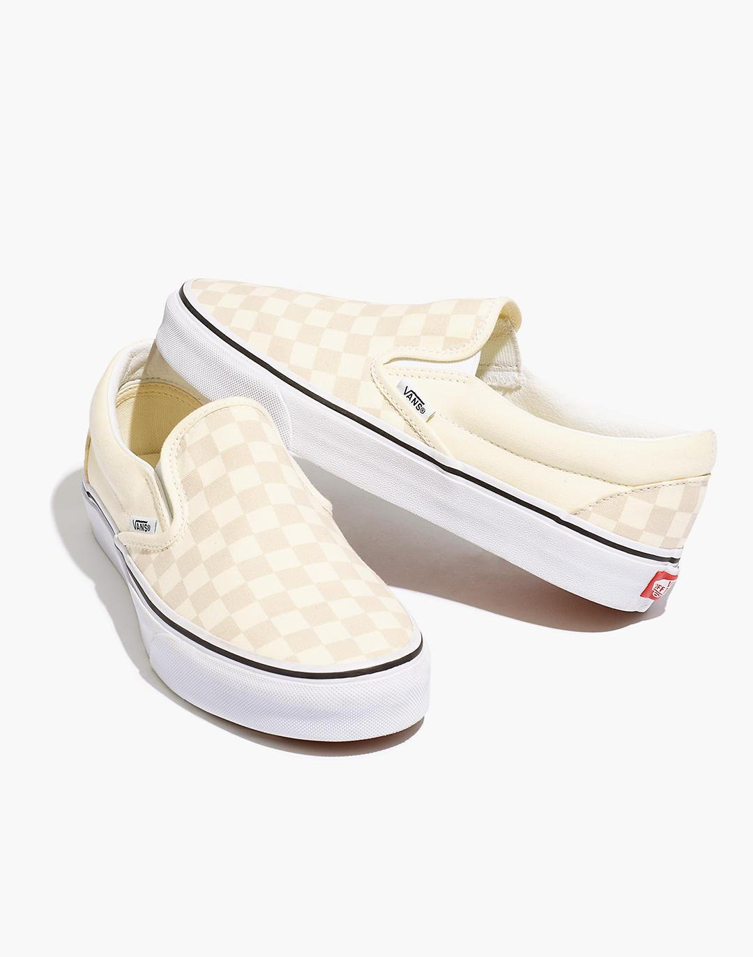 Vans® Unisex Classic Slip-On Sneakers in White Canvas