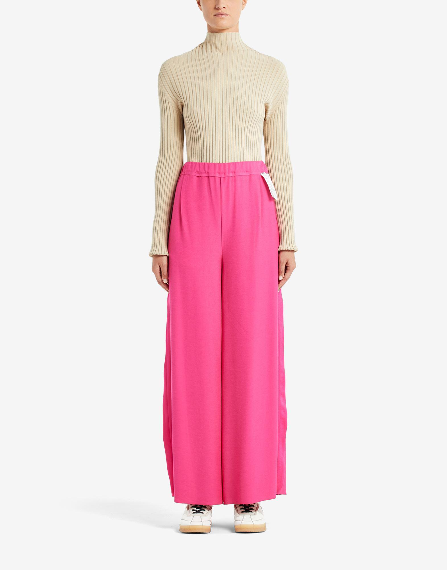 Reversed flare trousers